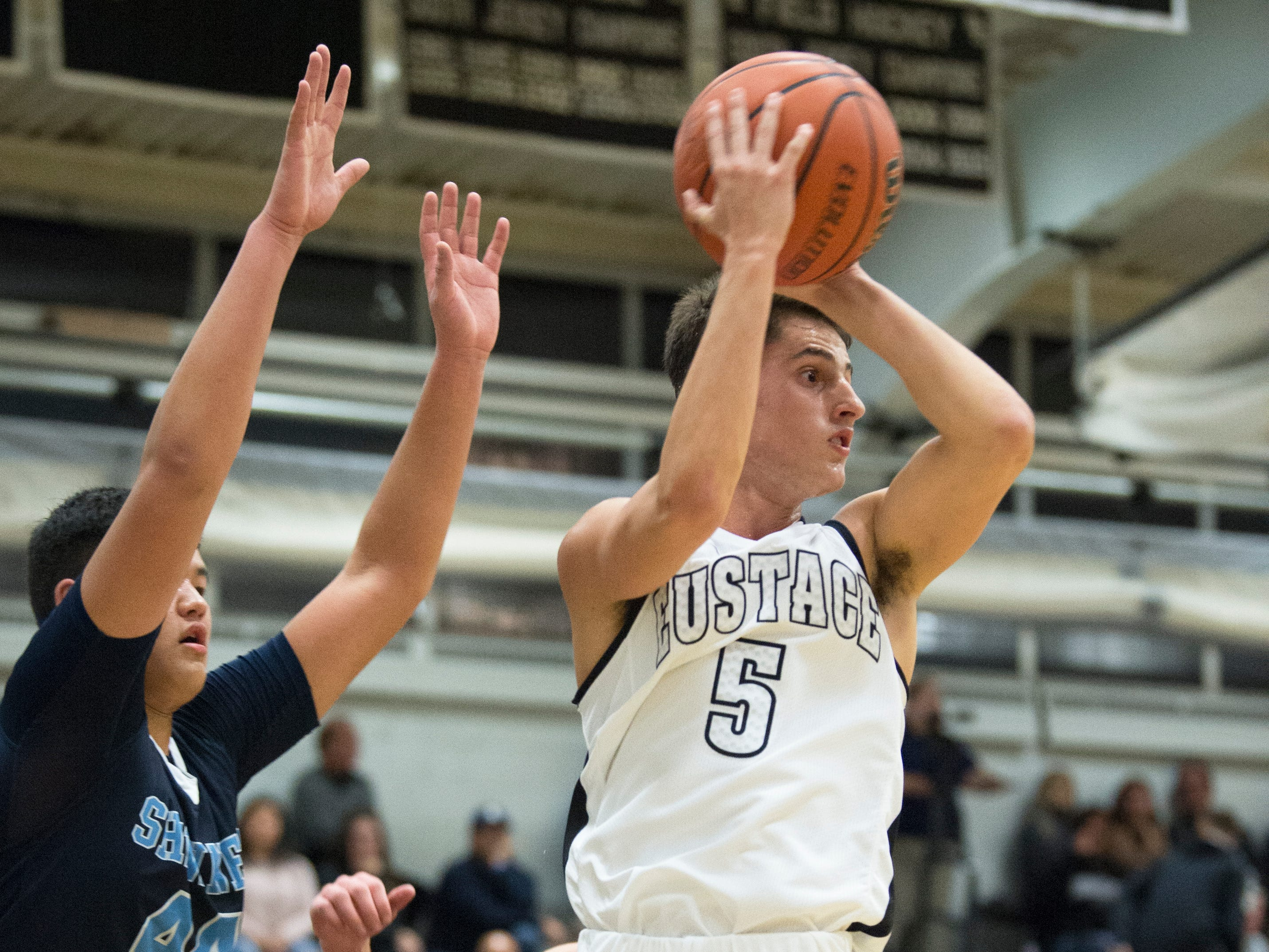 Bishop Eustace's David Cross passes the ball during the 1st quarter of the boys basketball game between Bishop Eustace and Shawnee played at Bishop Eustace High School in Pennsauken on Friday, December 14, 2018.  Bishop Eustace won, 51-35.