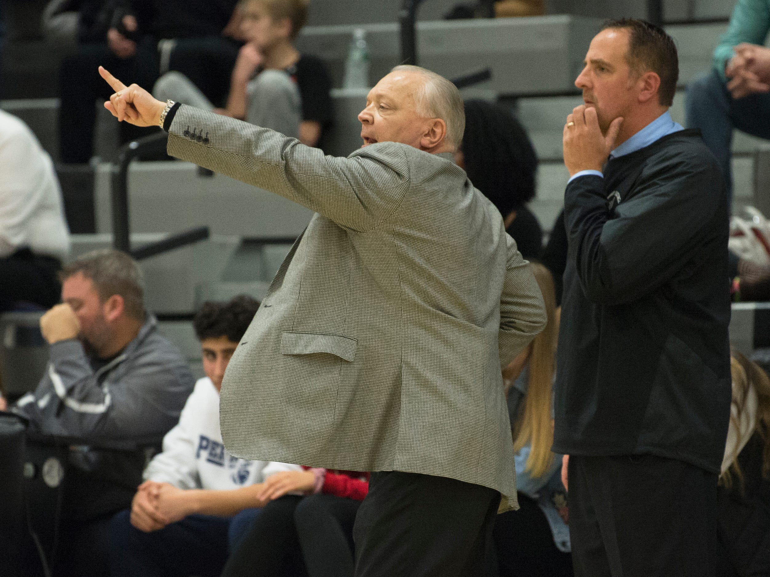 Bishop Eustace boys basketball coach Robert Falconiero instructs his players during the 1st quarter of the boys basketball game between Bishop Eustace and Shawnee played at Bishop Eustace High School in Pennsauken on Friday, December 14, 2018.  Bishop Eustace won, 51-35.