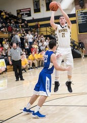 Forward Bryce Newland makes a jump shot to score for Paint Valley during the first half of their game against Southeastern in Bainbridge, Ohio. Paint Valley defeated Southeastern 60-55.