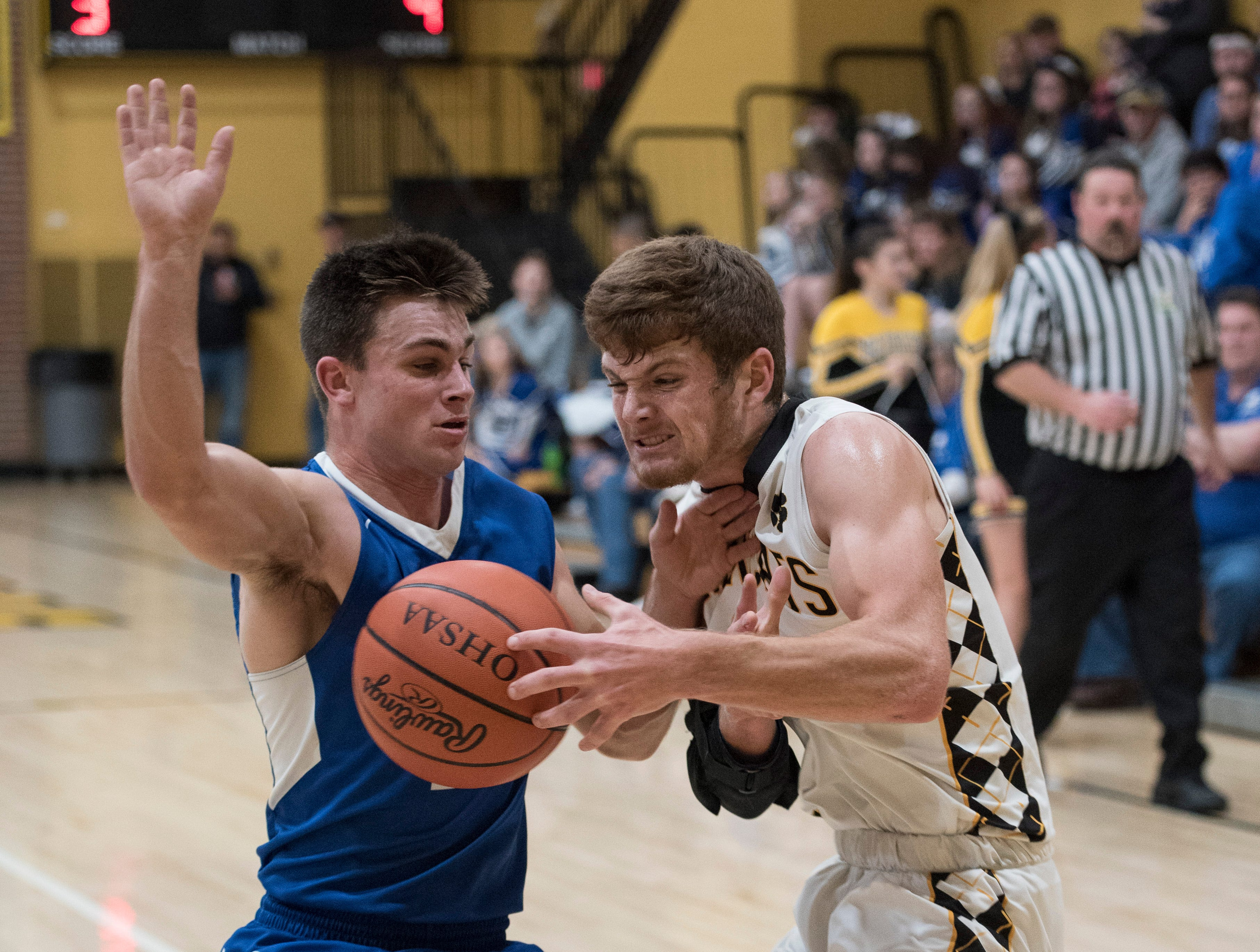 Southeastern junior Lane Ruby attempts to defend the ball as Paint Valley junior Cruz McFadden drives to the basket to score Friday night in Bainbridge, Ohio. Paint Valley defeated Southeastern 60-55.