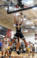 Greg Phelia Jr. (2) puts his whole body into a score for Walnut Hills, December 14, 2018.