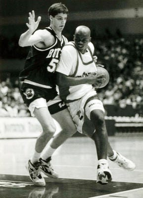 Dontonio Wingfield drives the lane during his playing days for UC.