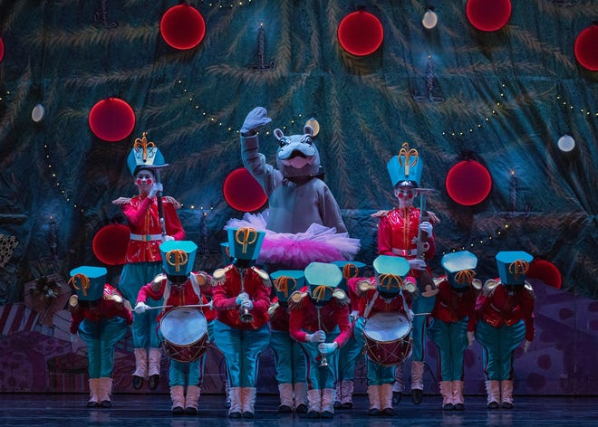 "Fiona, the Cincinnati Zoo's world-famous hippopotamus, makes an appearance in Cincinnati Ballet's 2018 production of ""The Nutcracker."" Here, she is seen with a group of the ballet's life-sized toy soldiers."