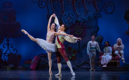 """Melissa Gelfin and Cervilio Miguel Amador are seen as the Sugar Plum Fairy and the Cotton Candy Cavalier the Cincinnati Ballet's 2018 production of """"The Nutcracker,"""" which runs through Dec. 24 at Music Hall."""