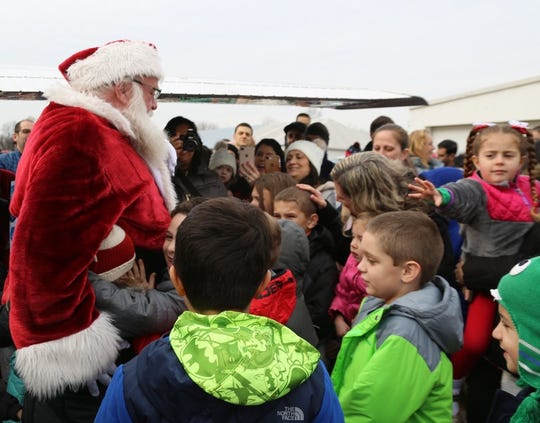 Santa has landed and ready to greet all the children attending the fly-In hosted by the Rotary Club of Branchburg.