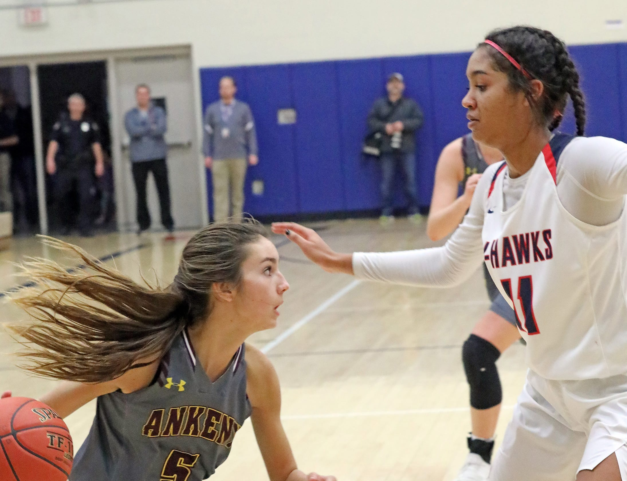 Ankeny junior guard Kayla Pitz tries to get past Urbandale junior forward Maya Gyamfi as the Ankeny Hawkettes compete against the Urbandale J-Hawks in high school basketball on Friday, Dec. 14, 2018 at Urbandale High School. Ankeny won 46 to 40.