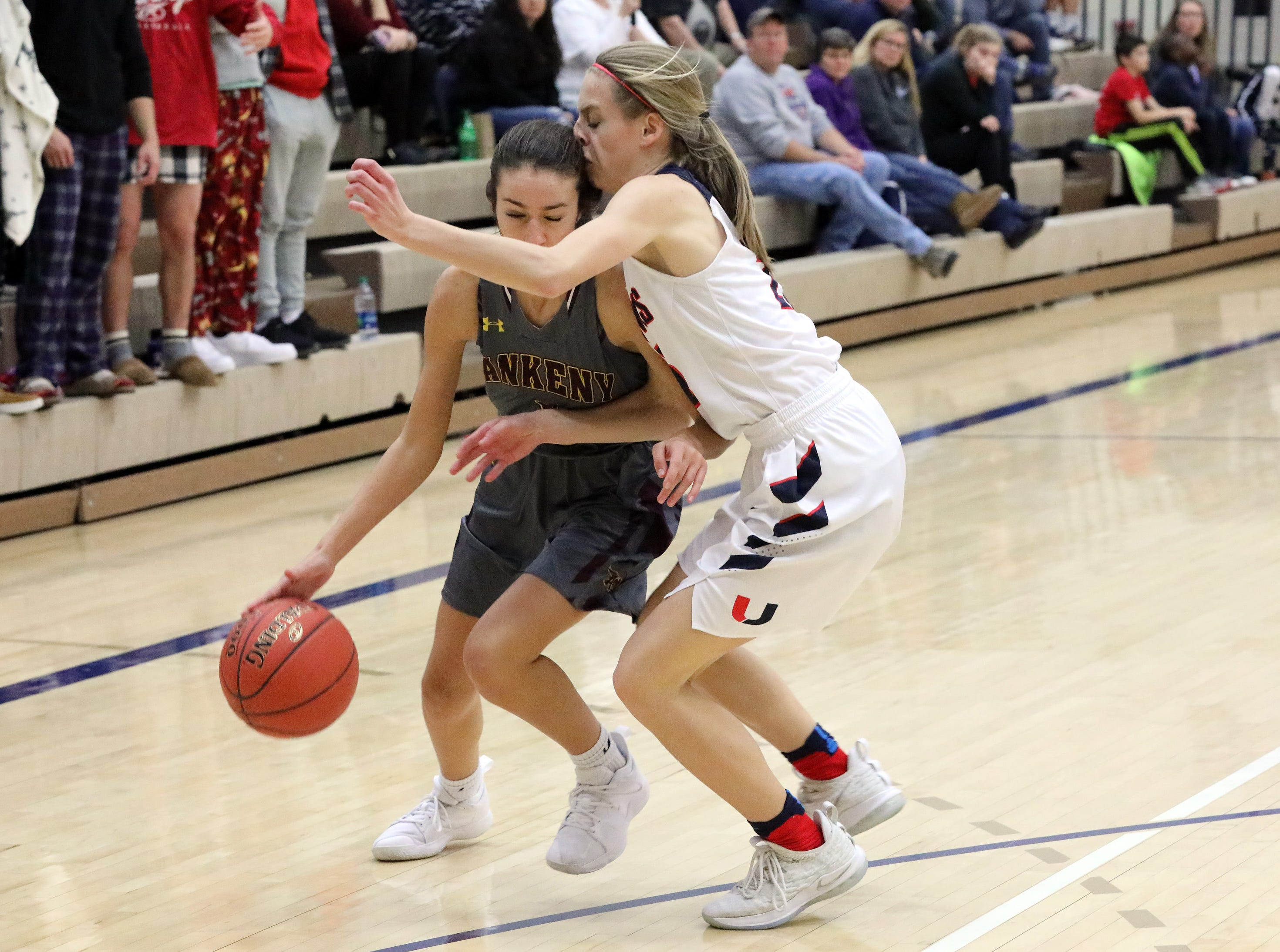 Ankeny junior guard Kayla Pitz and Urbandale sophomore guard Macy Gaskill  collide as the Ankeny Hawkettes compete against the Urbandale J-Hawks in high school basketball on Friday, Dec. 14, 2018 at Urbandale High School. Ankeny won 46 to 40.