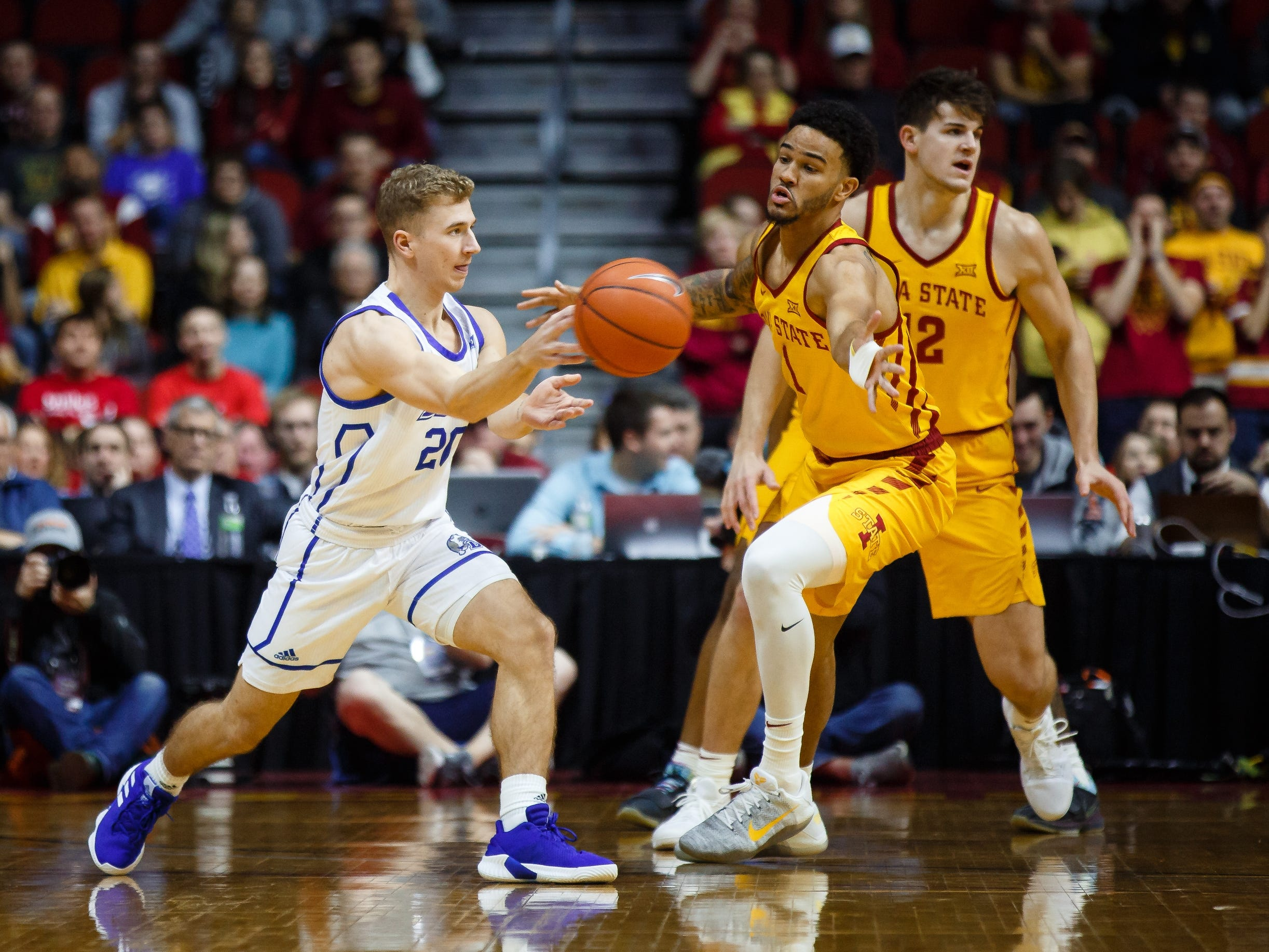 Drake's Nick Norton passes during their basketball game at the Hy-Vee Classic on Saturday, Dec. 15, 2018, in Des Moines. Iowa State takes a 36-32 lead into the half.