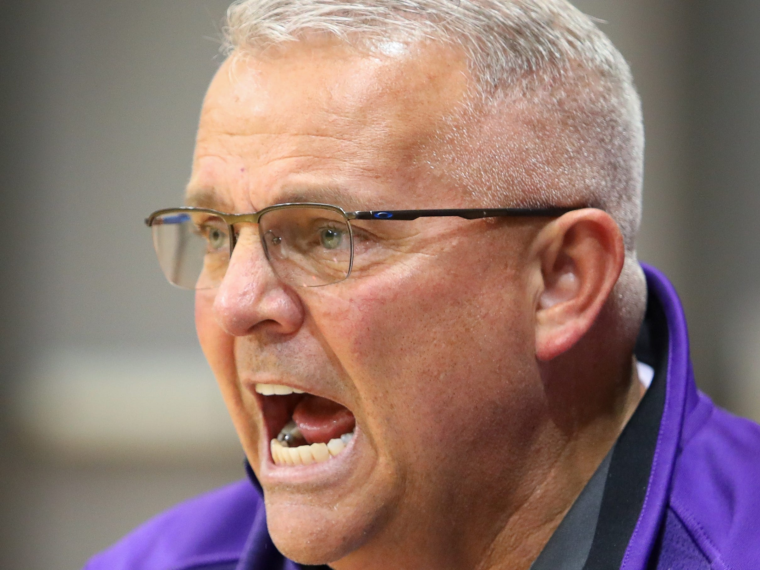 Waukee head coach Chris Guess yells out plays during a girls high school basketball game between the Valley Tigers and the Waukee Warriors at Waukee High School on Dec. 14, 2018 in Waukee, Iowa.