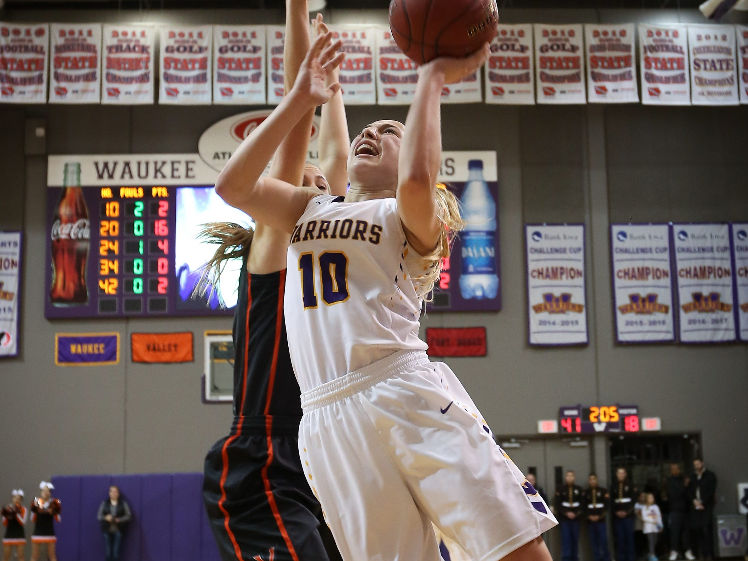 Waukee sophomore Katie Dinnebier goes for a layup during a girls high school basketball game between the Valley Tigers and the Waukee Warriors at Waukee High School on Dec. 14, 2018 in Waukee, Iowa.