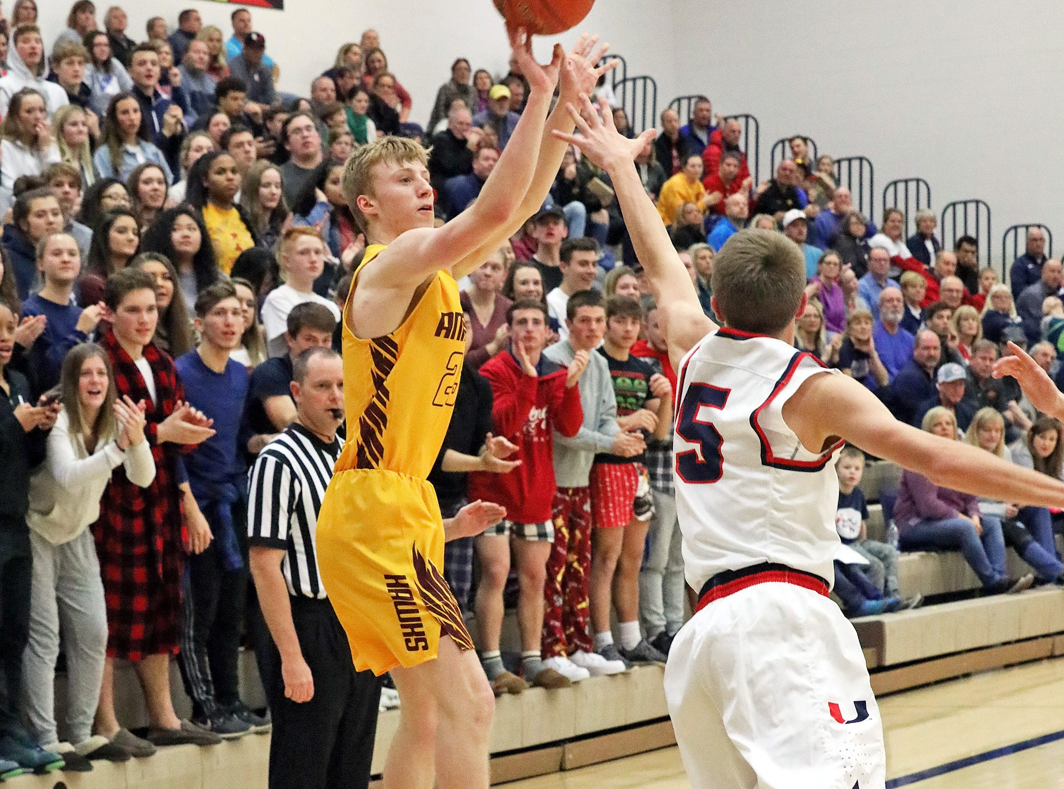 Ankeny senior sharpshooter Dillon Carlson hits another 3-pointer as the Ankeny Hawks compete against the Urbandale J-Hawks in high school basketball on Friday, Dec. 14, 2018 at Urbandale High School. Ankeny won 62 to 52 to remain undefeated at 6-0.