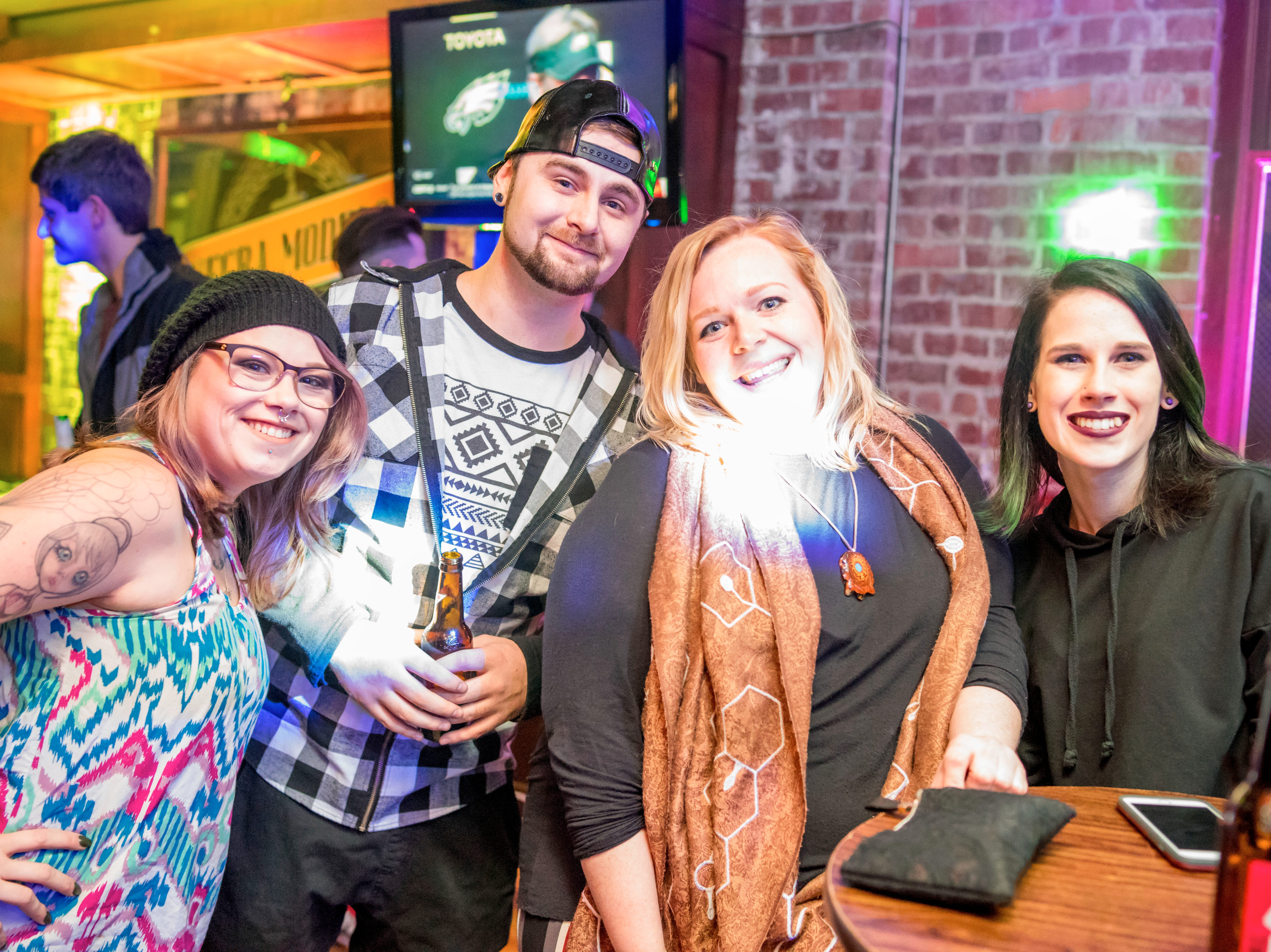 Jessica Nelson, 26, Nick Leoneti, 26, Maddie Noel, 27, and Madison Dorah, 22, all of Des Moines, having a fun time, Friday, Dec. 14 at Heroes.