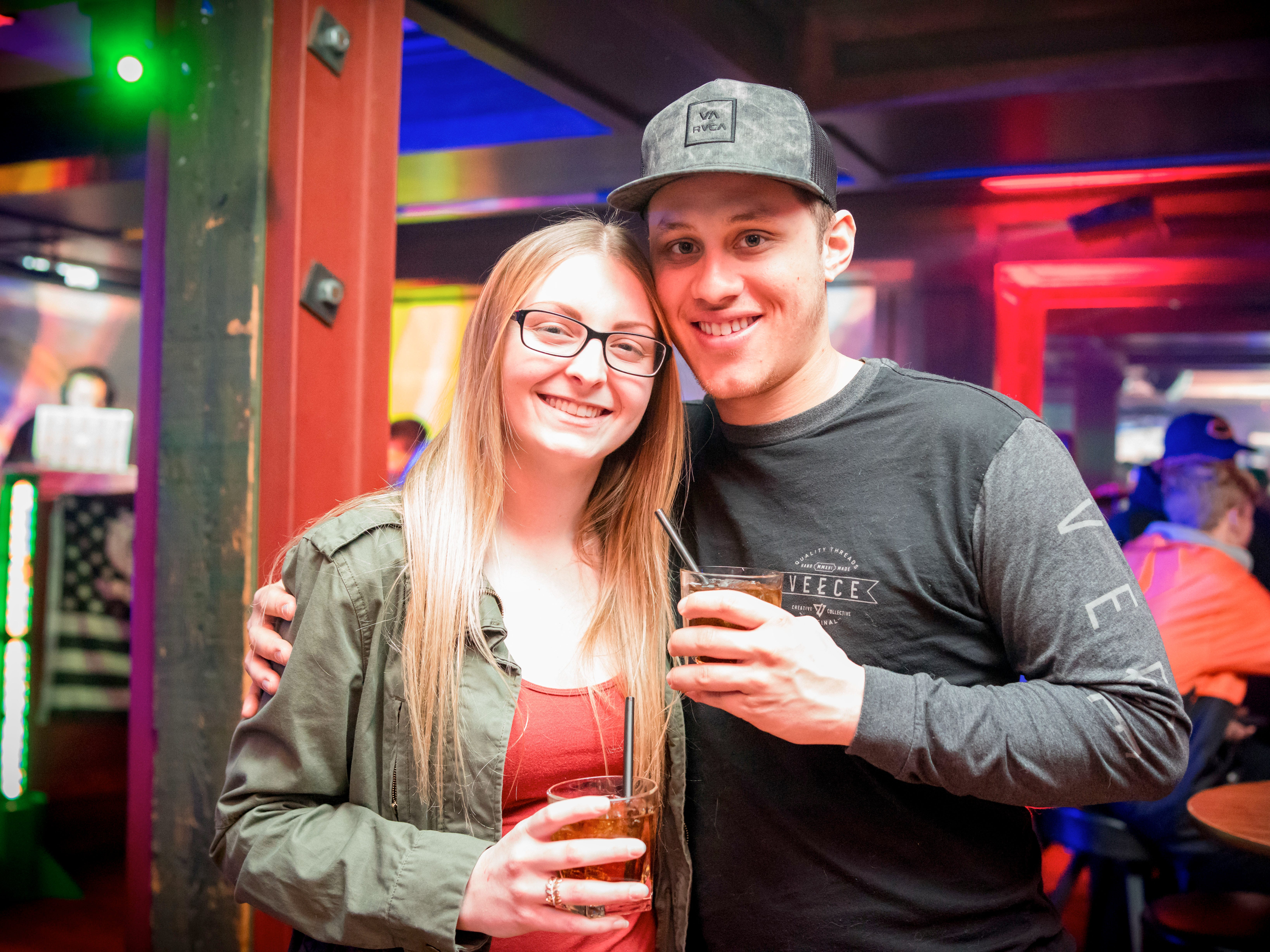 Haley McDaniel, 22, and Jarrod Krigel, 23, both of Des Moines, having a fun time, Friday, Dec. 14 at Heroes.
