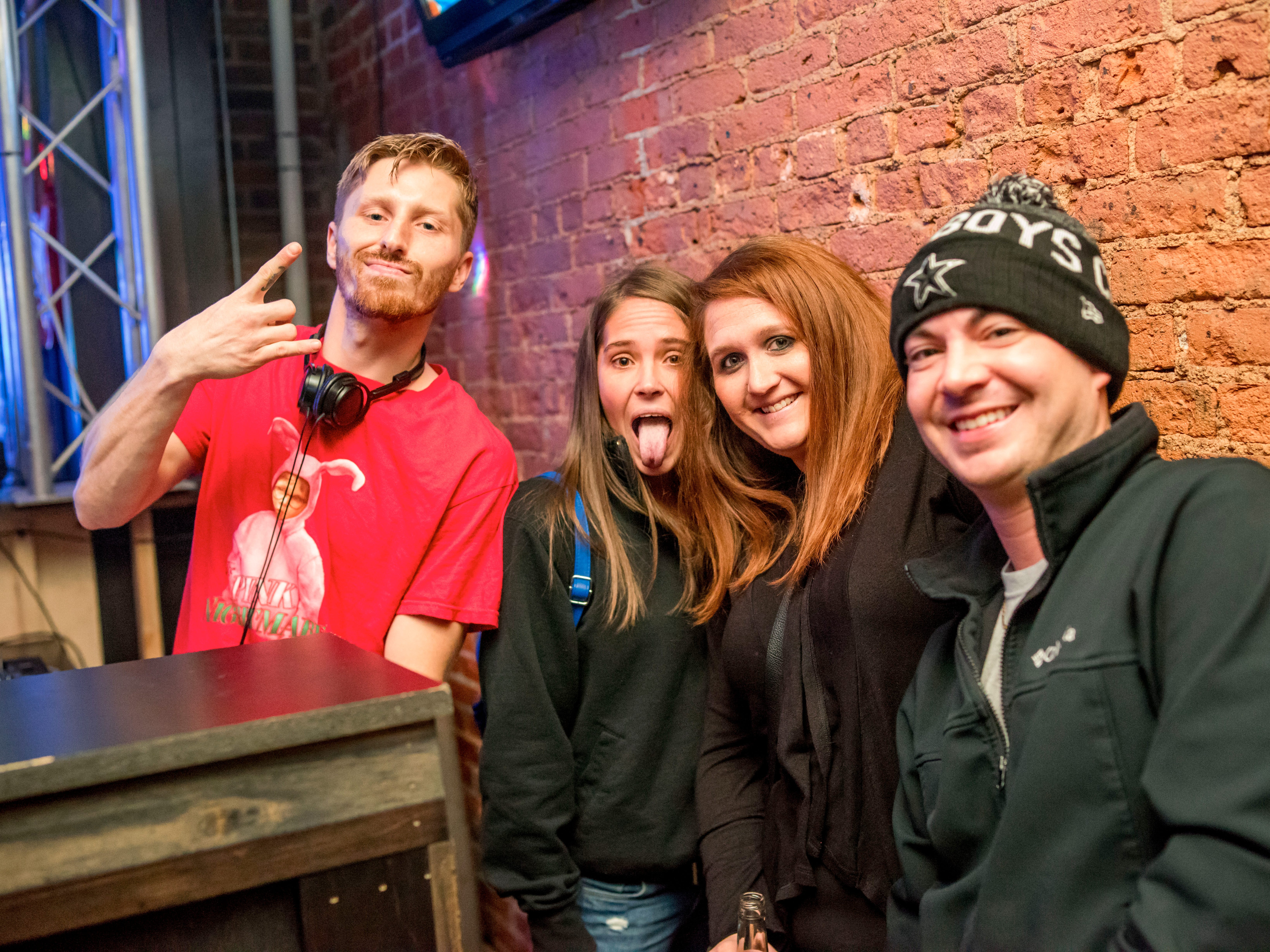 Josh Maganam, 28, Jessica Stevens, 31, Jessica Meeks, 29, and Kyle Hutchins, 29, all of Des Moines, having a great night, Friday, Dec. 14 at The District.