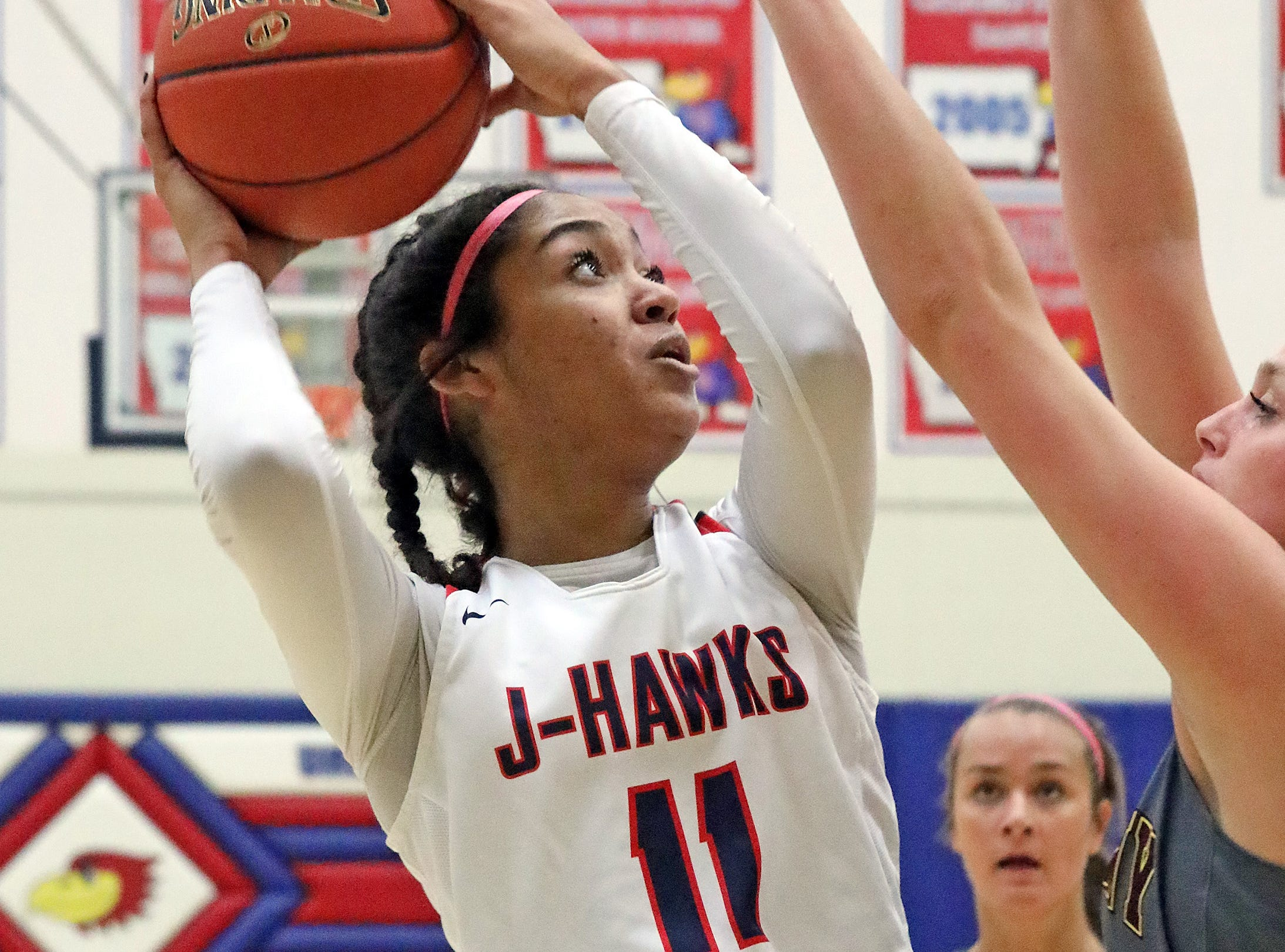 Urbandale junior forward Maya Gyamfi  shoots for two as the Ankeny Hawkettes compete against the Urbandale J-Hawks in high school basketball on Friday, Dec. 14, 2018 at Urbandale High School. Ankeny won 46 to 40.