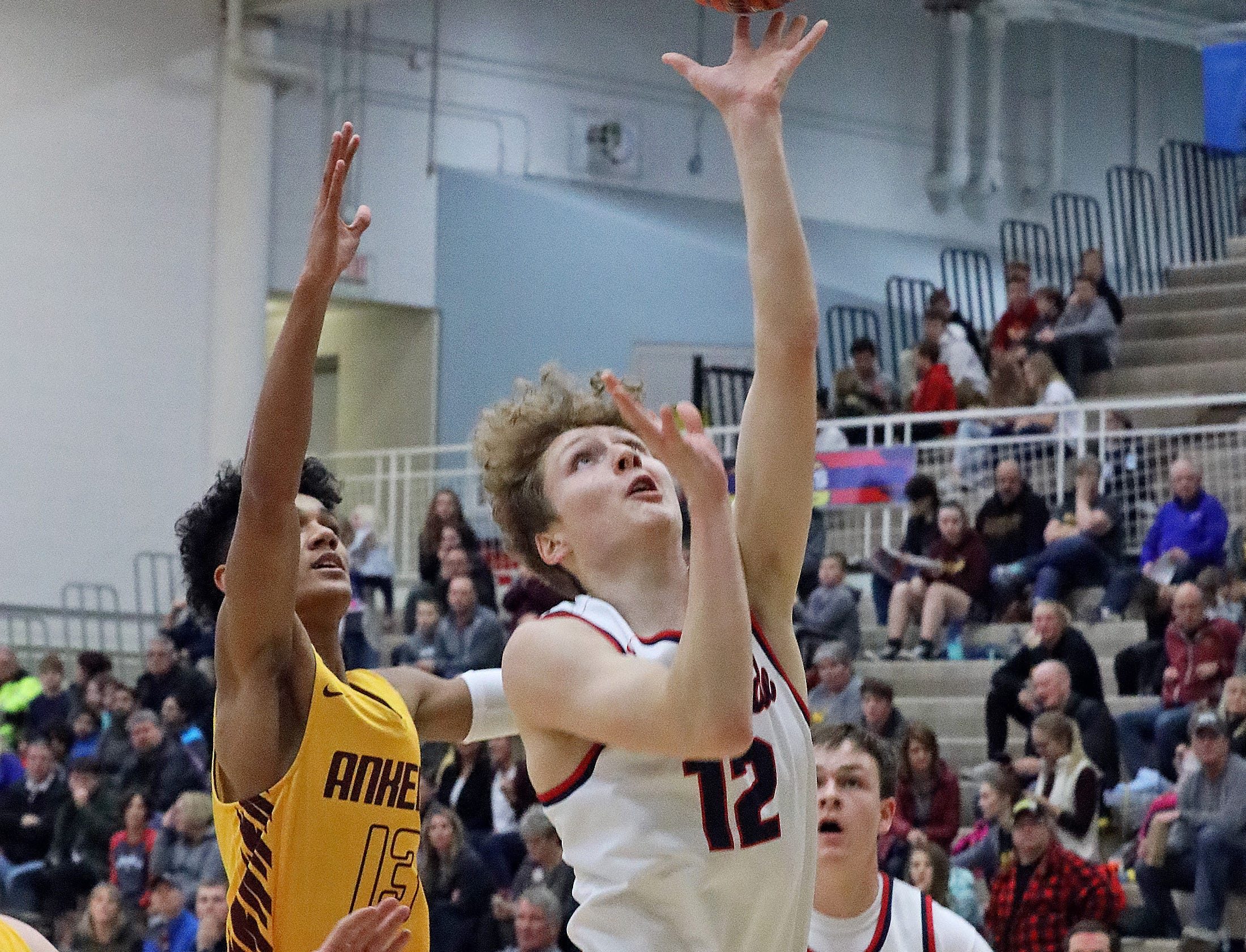 Urbandale junior guard Seth Anderson scores as the Ankeny Hawks compete against the Urbandale J-Hawks in high school basketball on Friday, Dec. 14, 2018 at Urbandale High School.