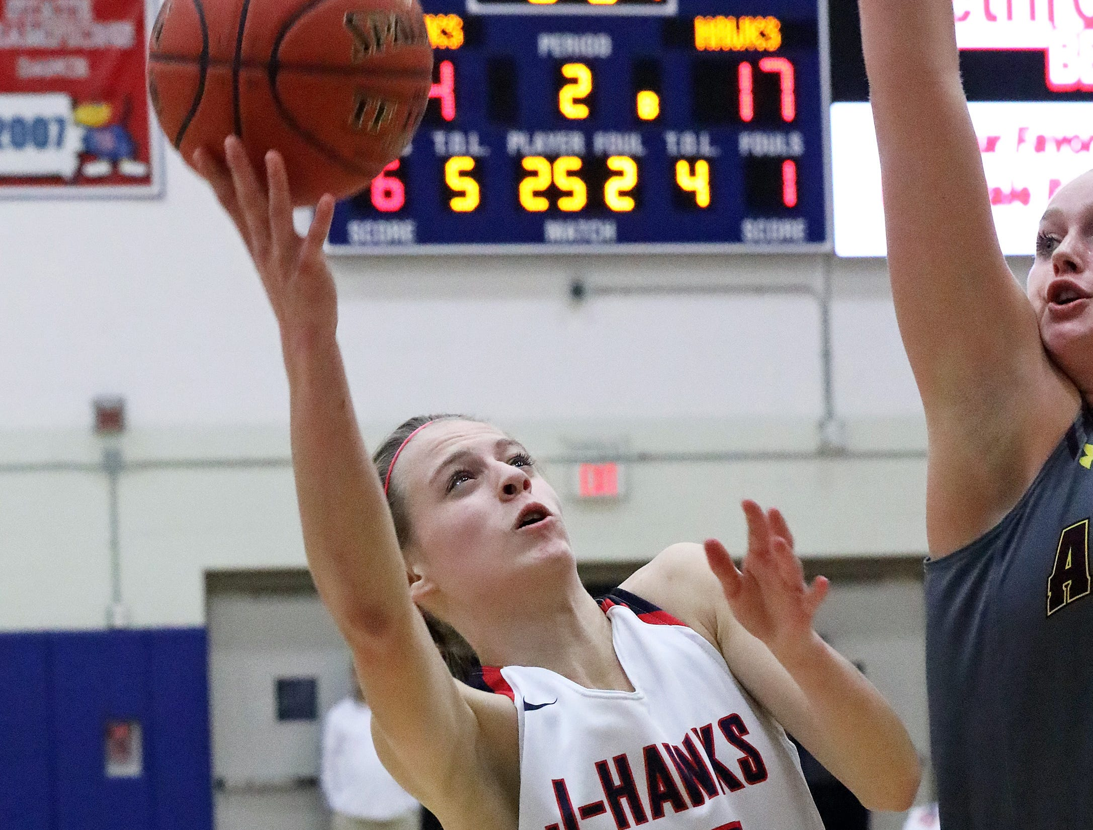 Urbandale sophomore guard Macy Gaskill works past the tough defense for a shot as the Ankeny Hawkettes compete against the Urbandale J-Hawks in high school basketball on Friday, Dec.14, 2018 at Urbandale High School. Ankeny won 46 to 40.