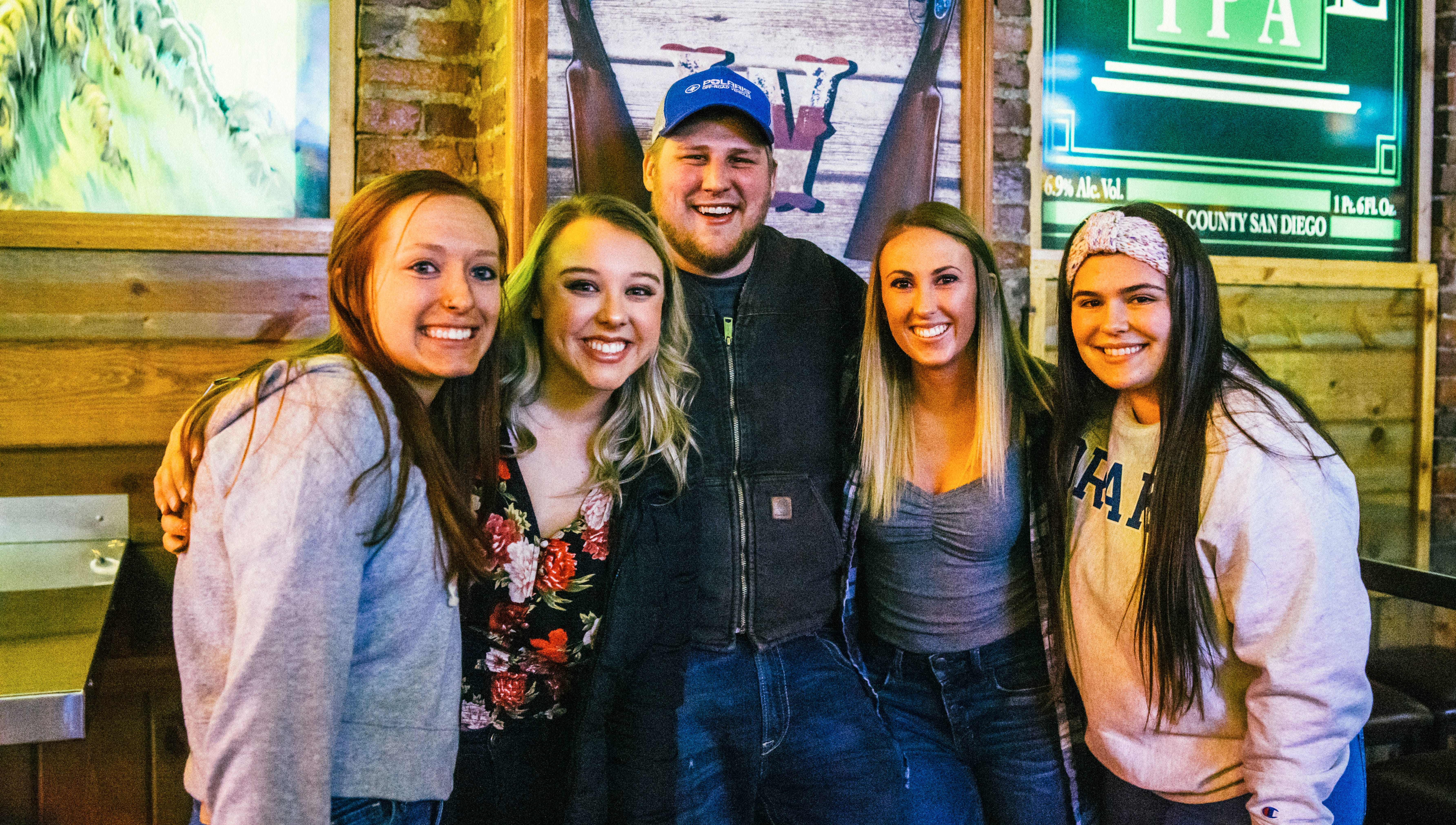 Katie Erickson, 22, Jacey Redman, 21, Glendan Mesch, 22, Elizabeth Ovrut, 22, and Baylee Heiden, 21, all of Des Moines, Friday, Dec. 14 at American Outlaws.