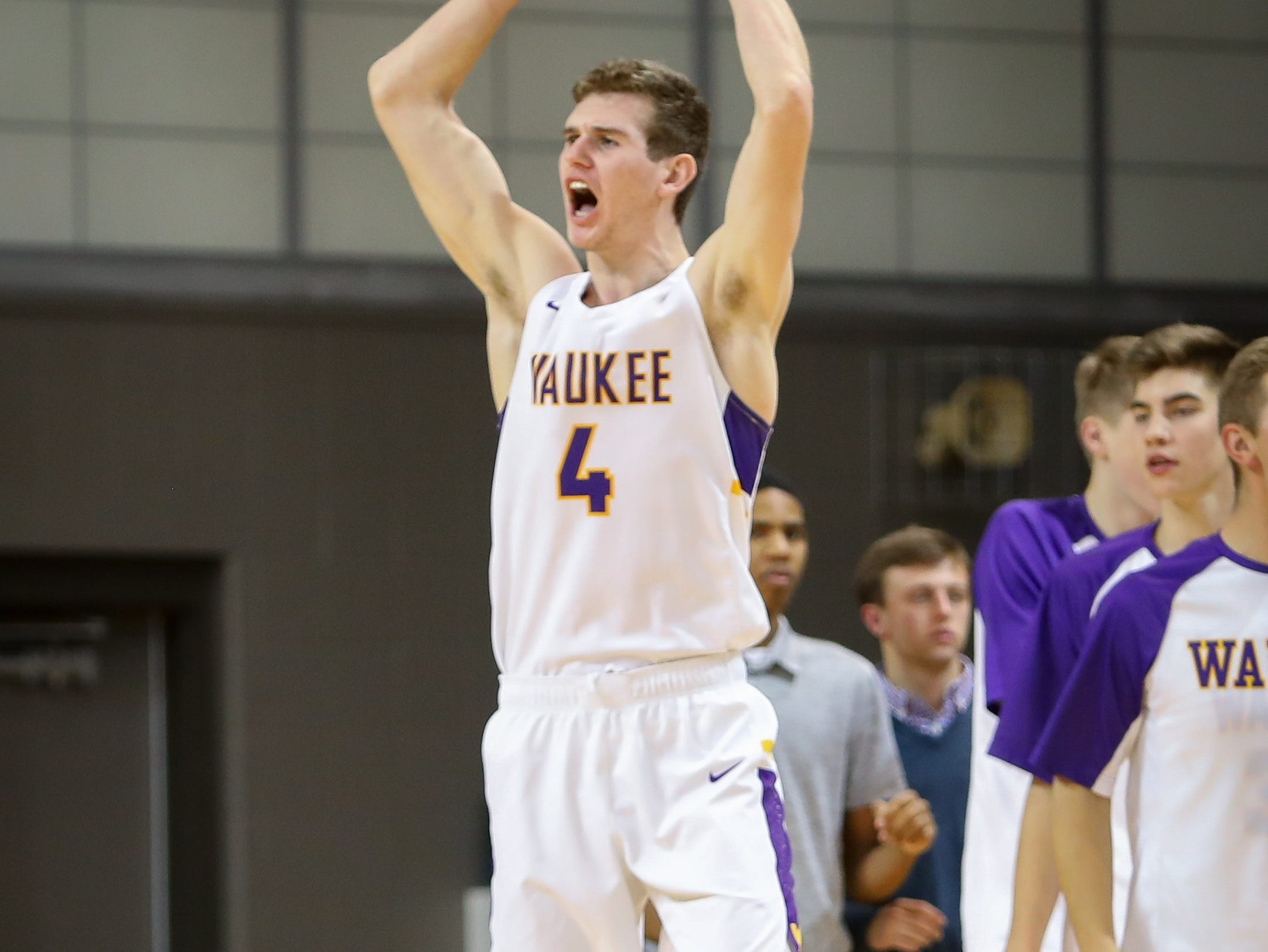 Waukee senior Dylan Jones celebrates by firing up the home crowd after the Warriors defeated the Valley Tigers, 49-48, at Waukee High School on Dec. 14, 2018 in Waukee, Iowa.