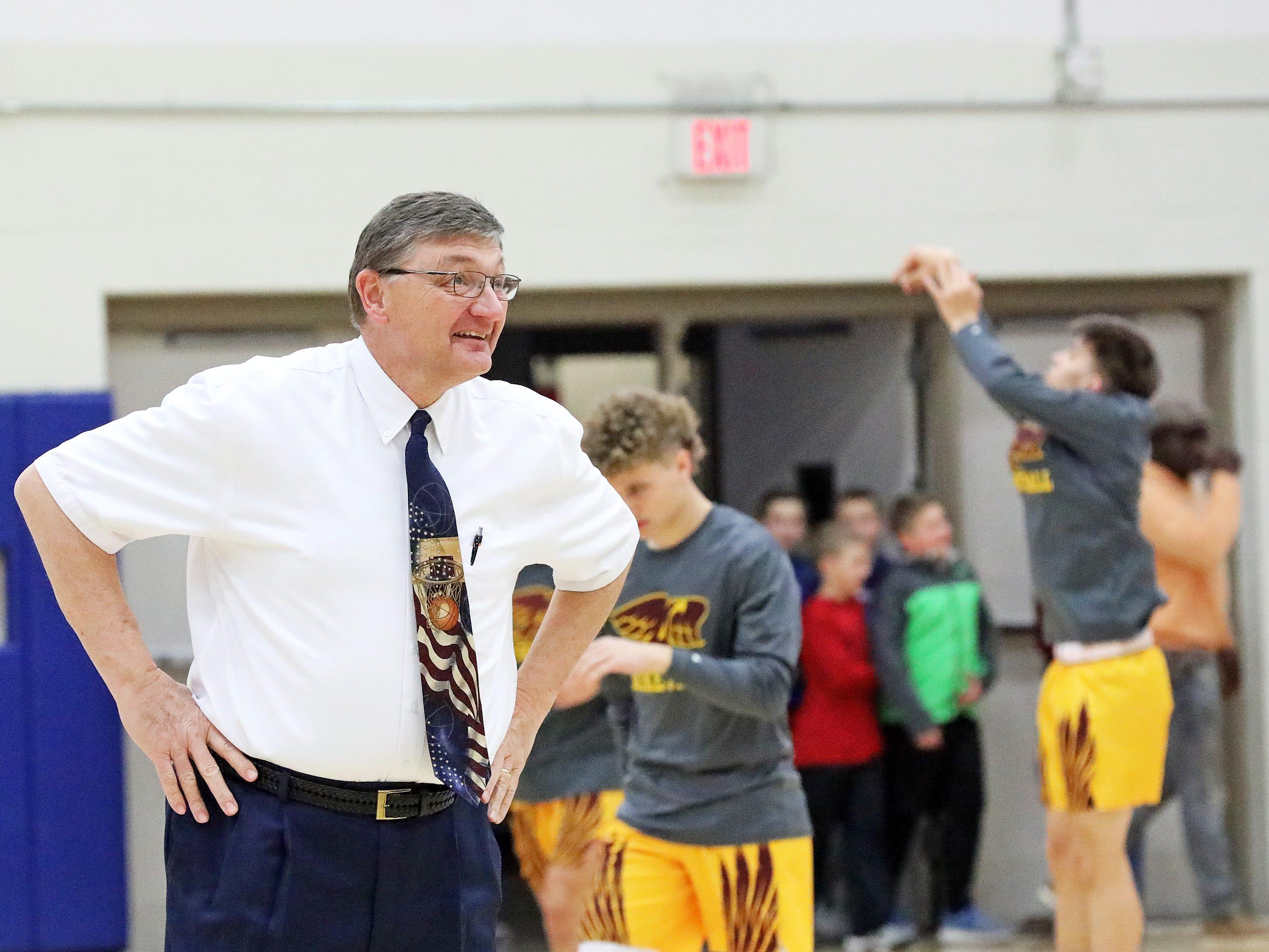 Matt Ellis helps coach the Urbandale boys team as they prepare for the Ankeny Hawks in high school basketball on Friday, Dec. 14, 2018 at Urbandale High School.