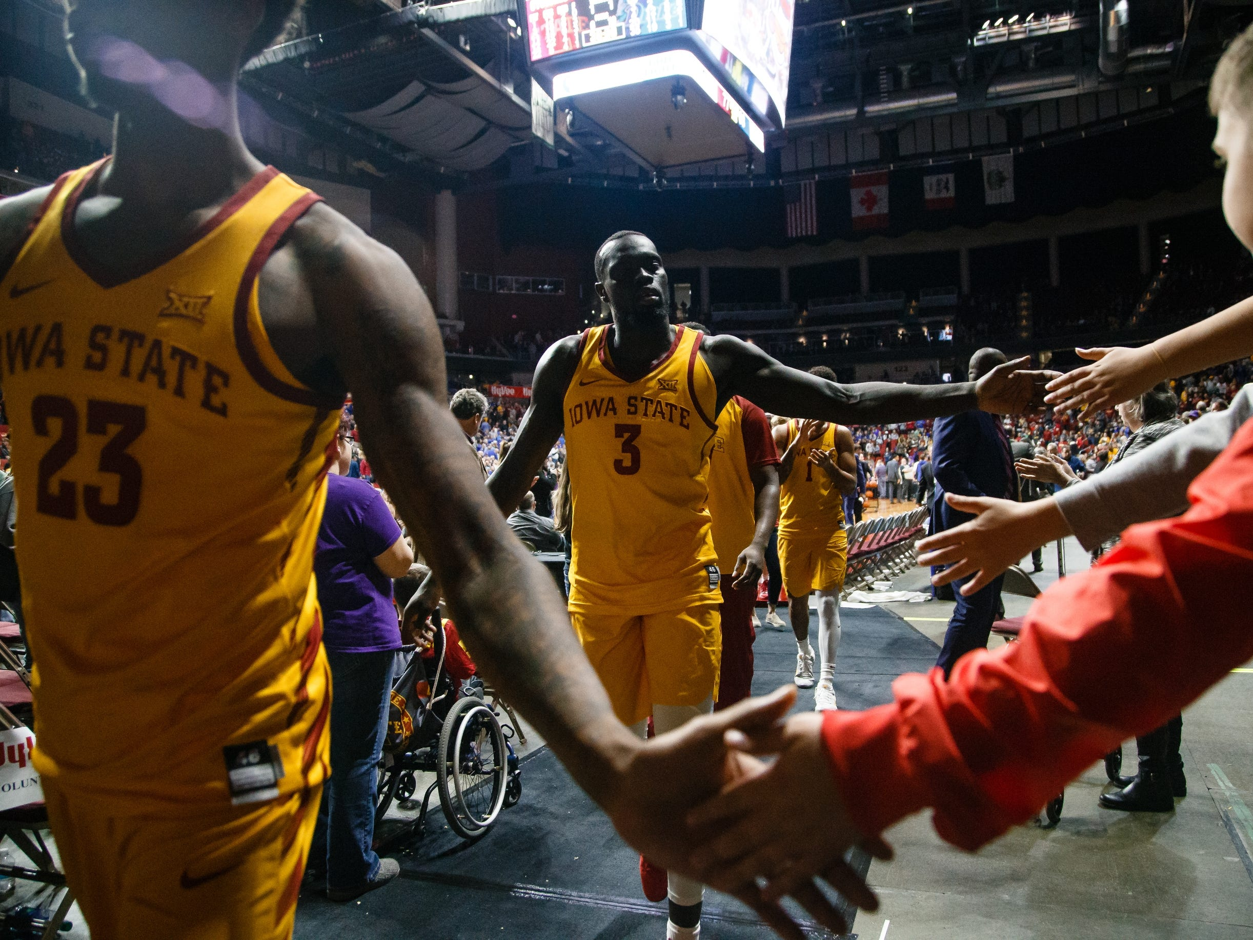 Iowa State's Marial Shayok (3) high-fives fans after the Cyclones defeated Drake 77-68 during their basketball game at the Hy-Vee Classic on Saturday, Dec. 15, 2018, in Des Moines.