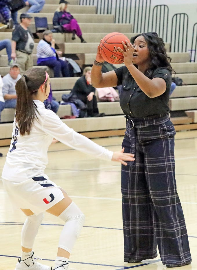 Charmaine Bell, former 2007 All-State guard at Roosevelt High, now serves as an assistant coach with the Urbandale girls team as they prepare to take on the Ankeny Hawkettes in high school basketball on Friday, Dec. 14, 2018 at Urbandale High School. Ankeny won 46 to 40.