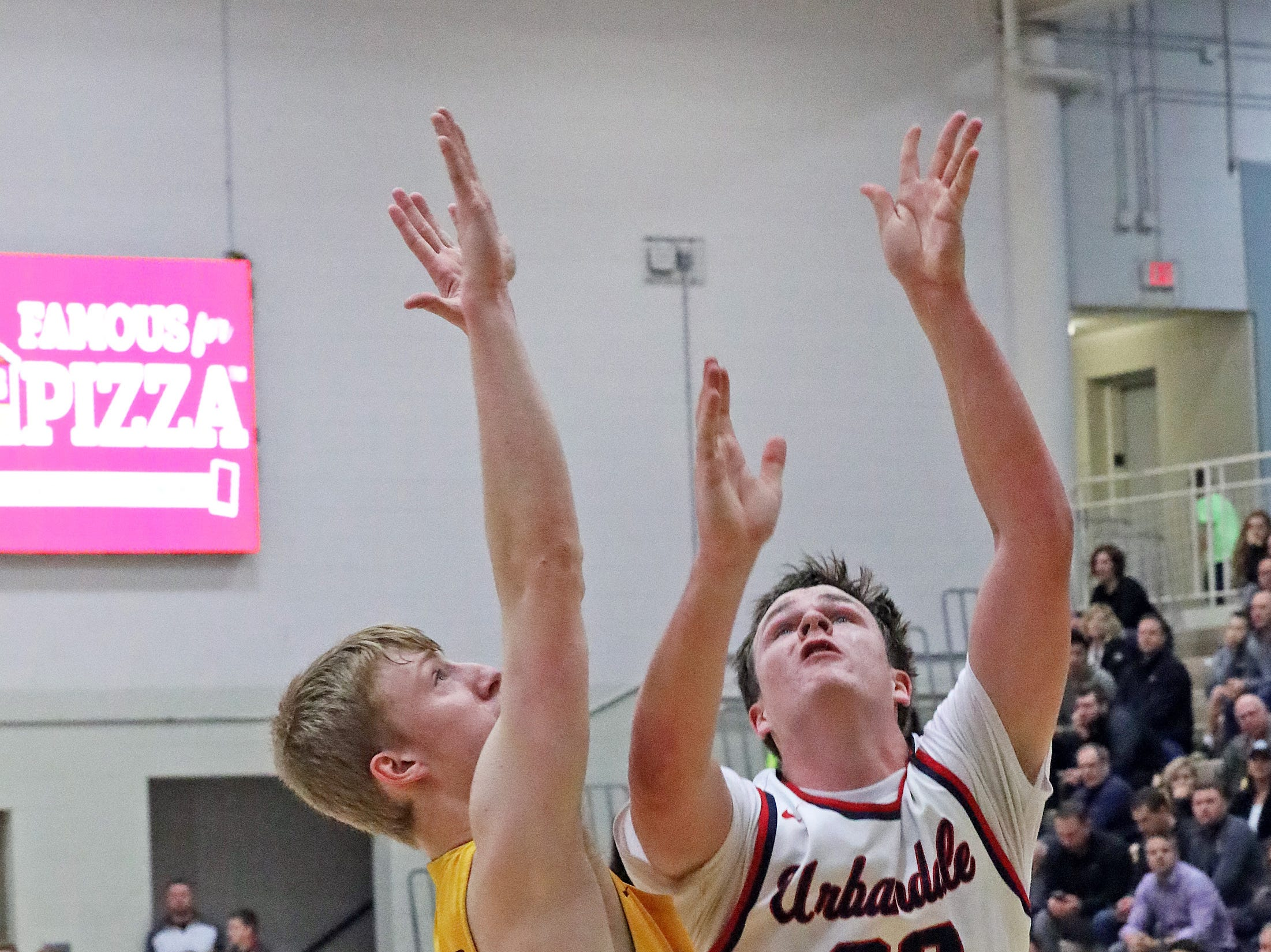 Urbandale senior Lucas Strain shoots over the strong defense of Ankeny senior Dillon Carlson as the Ankeny Hawks compete against the Urbandale J-Hawks in high school basketball on Friday, Dec. 14, 2018 at Urbandale High School. Ankeny won 62 to 52 to remain undefeated at 6-0.
