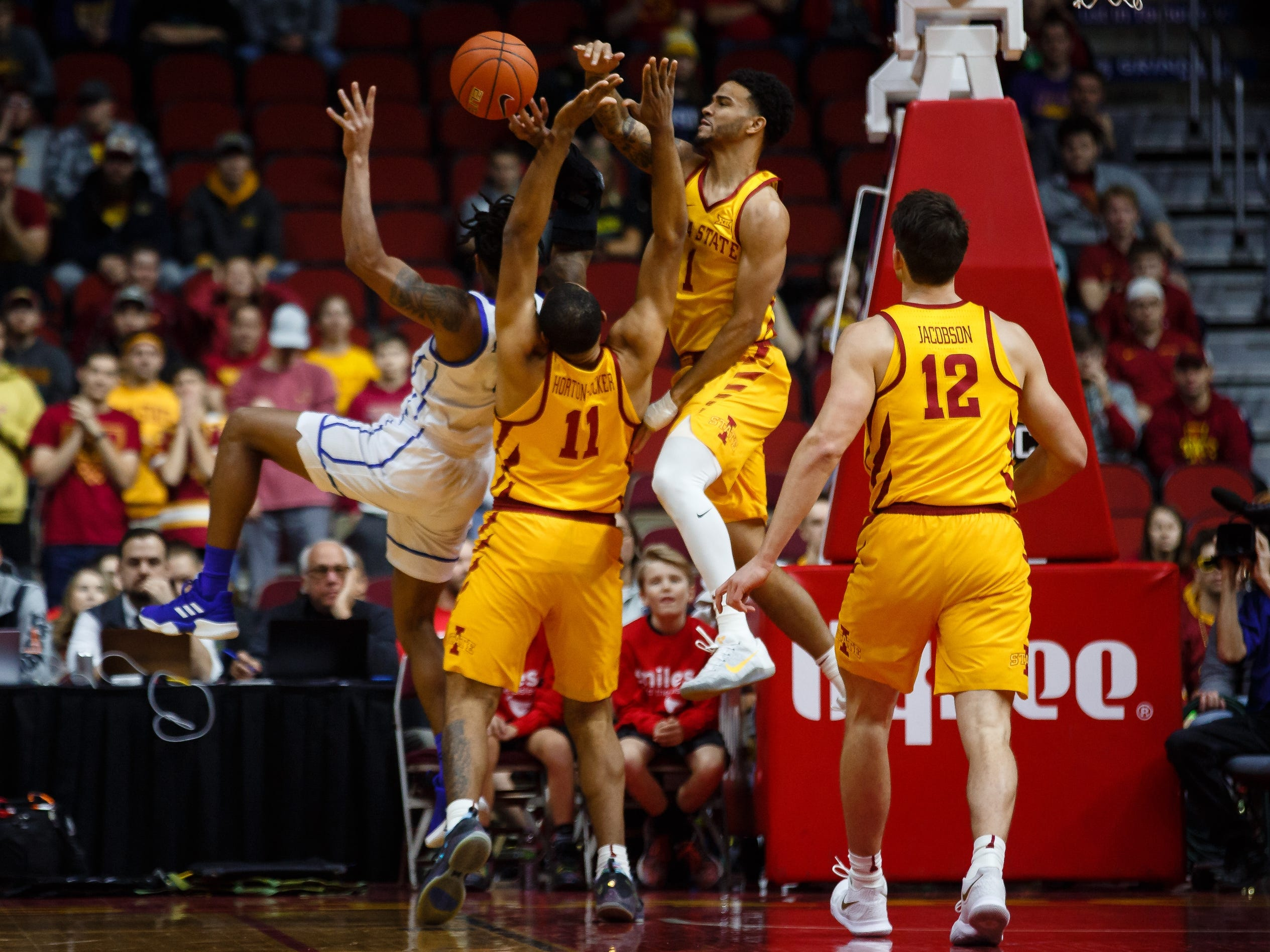 Iowa State's Nick Weiler-Babb (1) blocks the shot of Drake's TremellÊMurphy (2) during their game at the Hy-Vee Classic on Saturday, Dec. 15, 2018, in Des Moines. Iowa State takes a 36-32 lead into the half.
