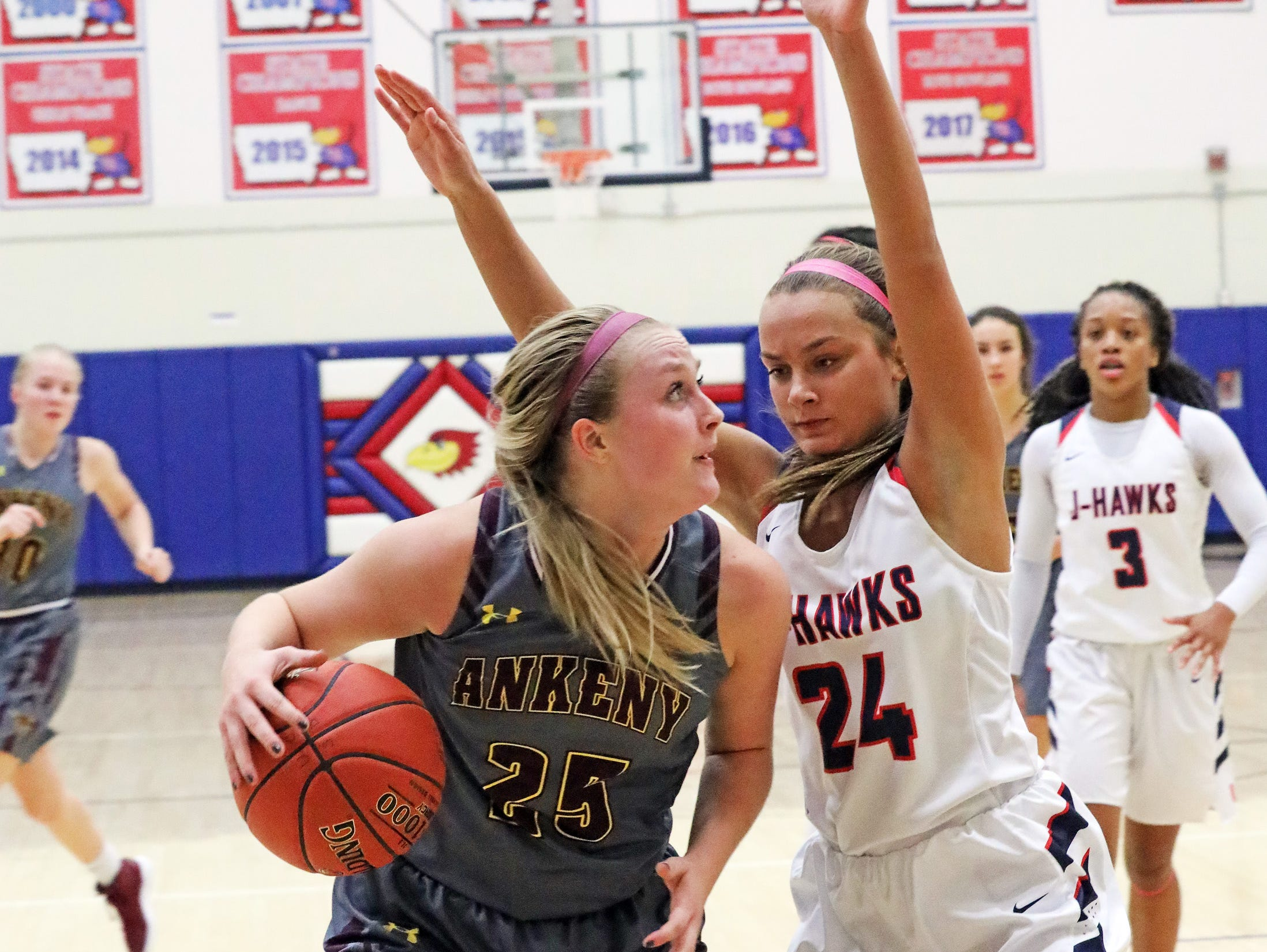 Ankeny senior Sara McCullough tries to get past the defense of Urbandale sophomore forward Madi Lynch as the Ankeny Hawkettes compete against the Urbandale J-Hawks in high school basketball on Friday, Dec. 14, 2018 at Urbandale High School. Ankeny won 46 to 40.
