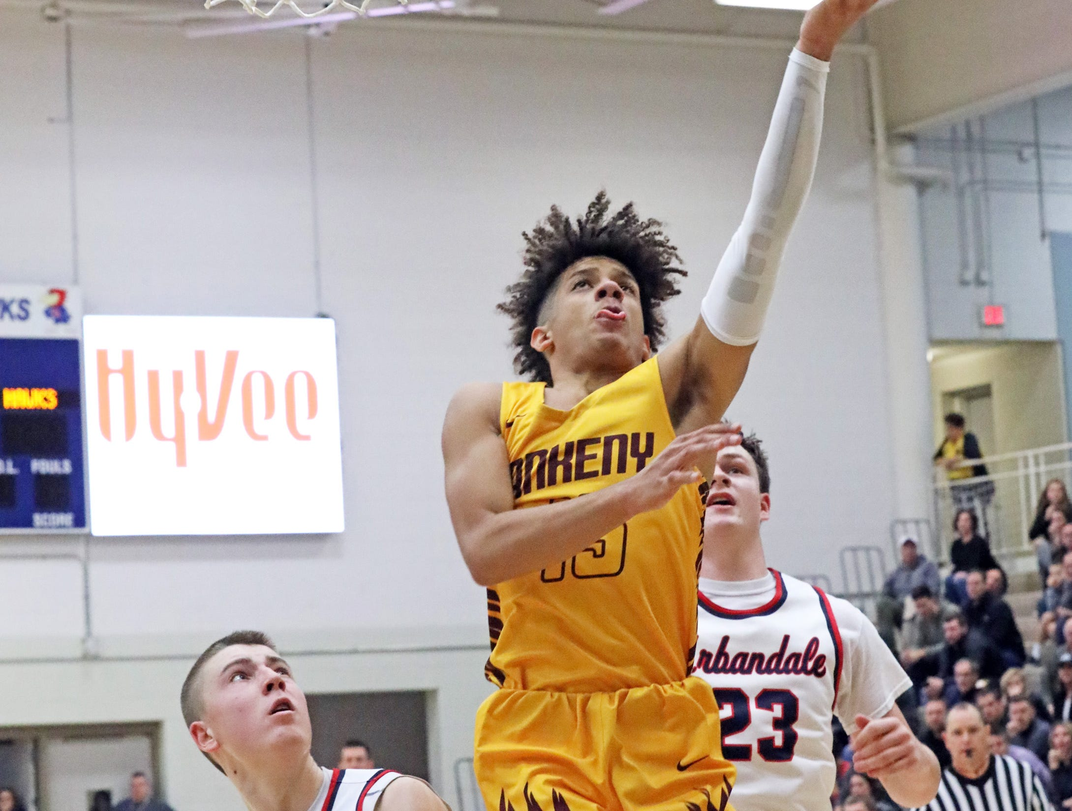 Ankeny junior Braxton Bayless scores two points as the Ankeny Hawks compete against the Urbandale J-Hawks in high school basketball on Friday, Dec. 14, 2018 at Urbandale High School. Ankeny won 62 to 52 to remain undefeated at 6-0.