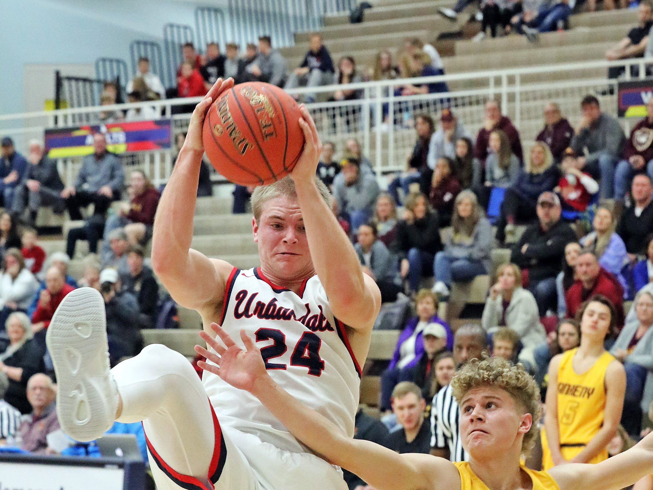 Urbandale senior guard Will Pattison pulls down the rebound before Ankeny junior Jordan Kumm as the Ankeny Hawks compete against the Urbandale J-Hawks in high school basketball on Friday, Dec. 14, 2018 at Urbandale High School. Ankeny won 62 to 52 to remain undefeated at 6-0.
