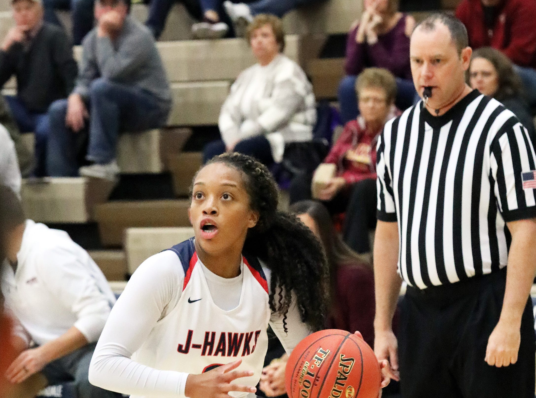 Urbandale senior guard Dee Dee Pryor drives towards the basket as the Ankeny Hawkettes compete against the Urbandale J-Hawks in high school basketball on Friday, Dec. 14, 2018 at Urbandale High School. Ankeny won 46 to 40.