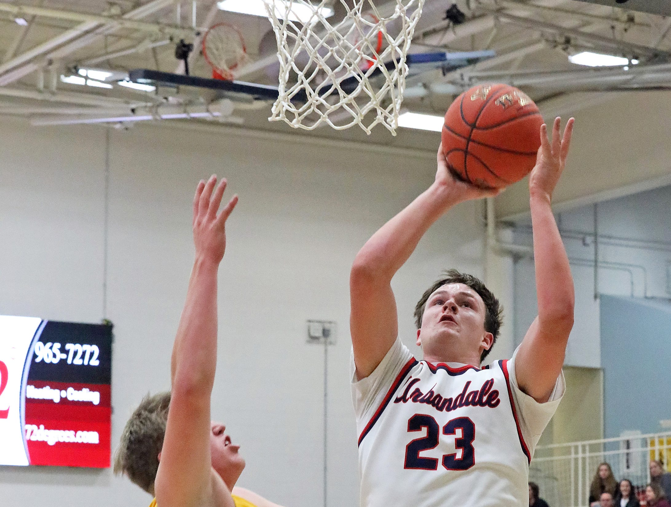 Urbandale senior Lucas Strain scores two points as the Ankeny Hawks compete against the Urbandale J-Hawks in high school basketball on Friday, Dec. 14, 2018 at Urbandale High School. Ankeny won 62 to 52 to remain undefeated at 6-0.