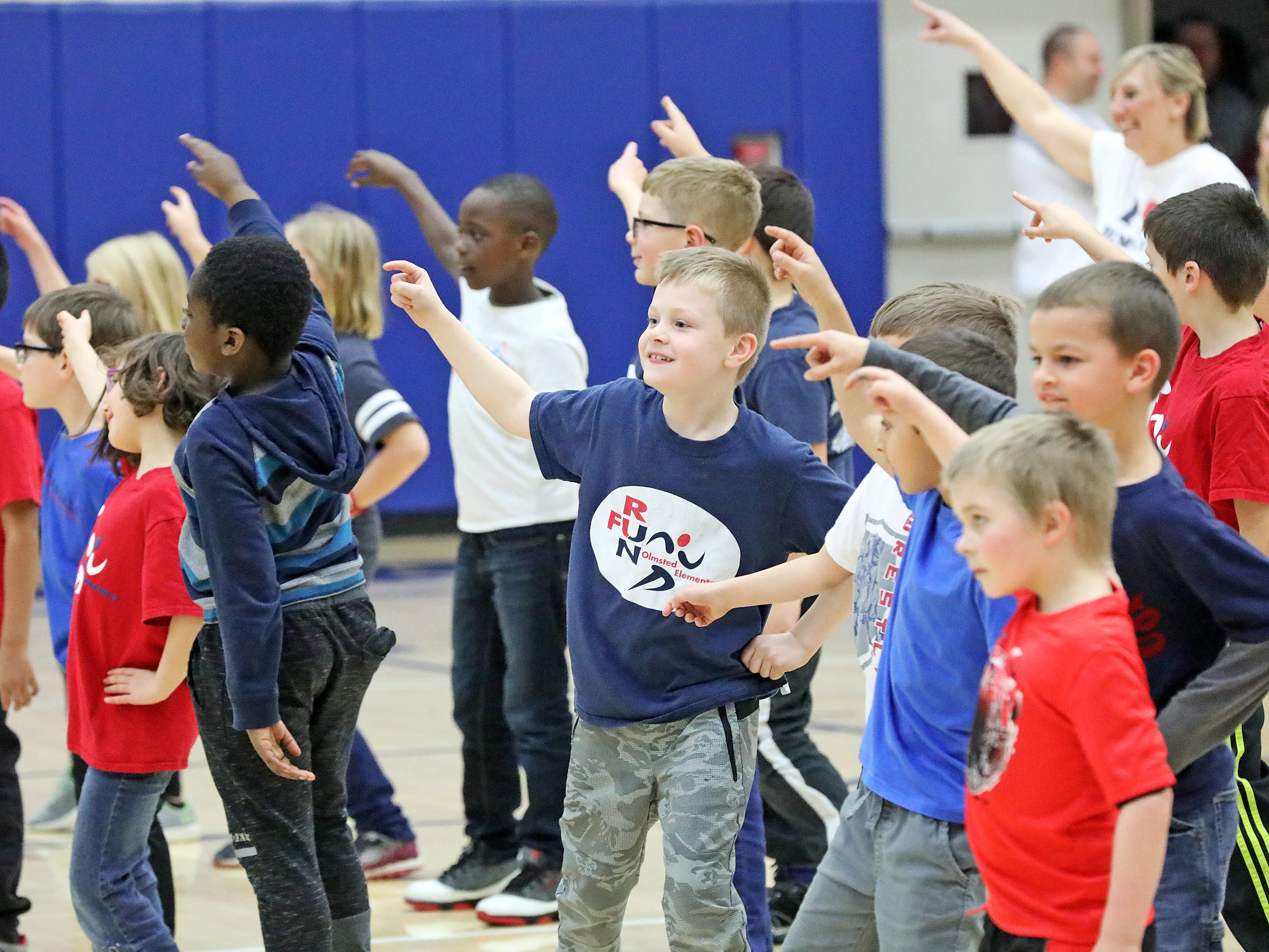 Students from Olmsted Elementary in Urbandale dance during the half-time show as the Ankeny Hawks compete against the Urbandale J-Hawks in high school basketball on Friday, Dec. 14, 2018 at Urbandale High School. Ankeny won 62 to 52 to remain undefeated at 6-0.