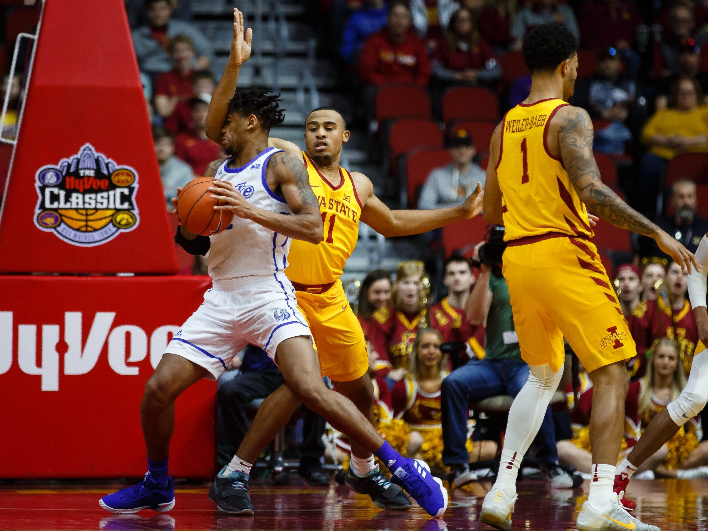 Iowa State's Talen Horton-Tucker tries to block Drake's Tremell Murphy during their game at the Hy-Vee Classic on Saturday, Dec. 15, 2018, in Des Moines. Iowa State takes a 36-32 lead into the half.