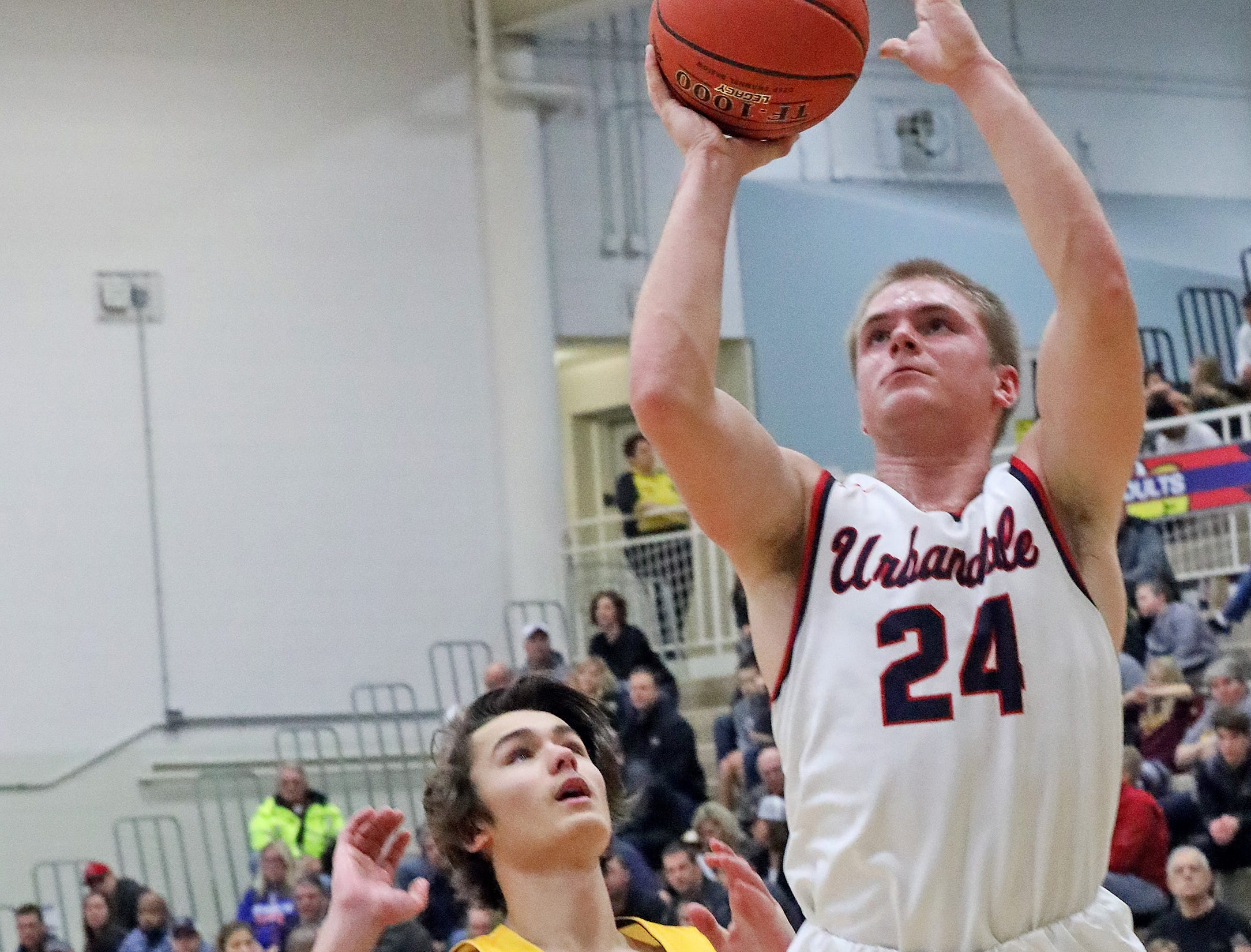Urbandale senior guard Will Pattison shoots for two as the Ankeny Hawks compete against the Urbandale J-Hawks in high school basketball on Friday, Dec. 14, 2018 at Urbandale High School. Ankeny won 62 to 52 to remain undefeated at 6-0.