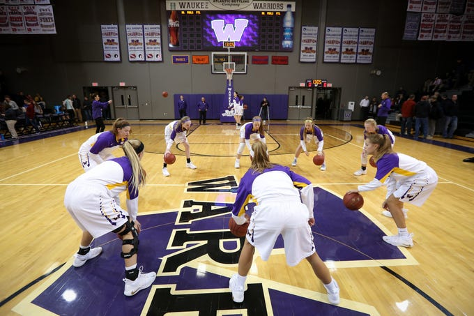 Members of the Warriors warm-up before a girls high school basketball game between the Valley Tigers and the Waukee Warriors at Waukee High School on Dec. 14, 2018 in Waukee, Iowa.