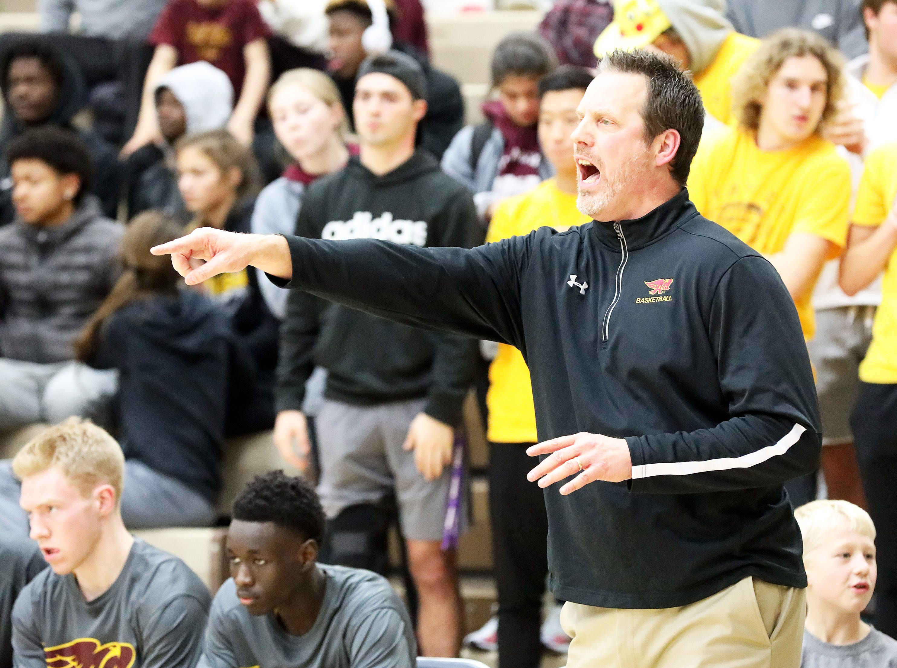 Ankeny Hawks head coach Brandt Carlson directs his team as the Ankeny Hawks compete against the Urbandale J-Hawks in high school basketball on Friday, Dec. 14, 2018 at Urbandale High School. Ankeny won 62 to 52 to remain undefeated at 6-0.