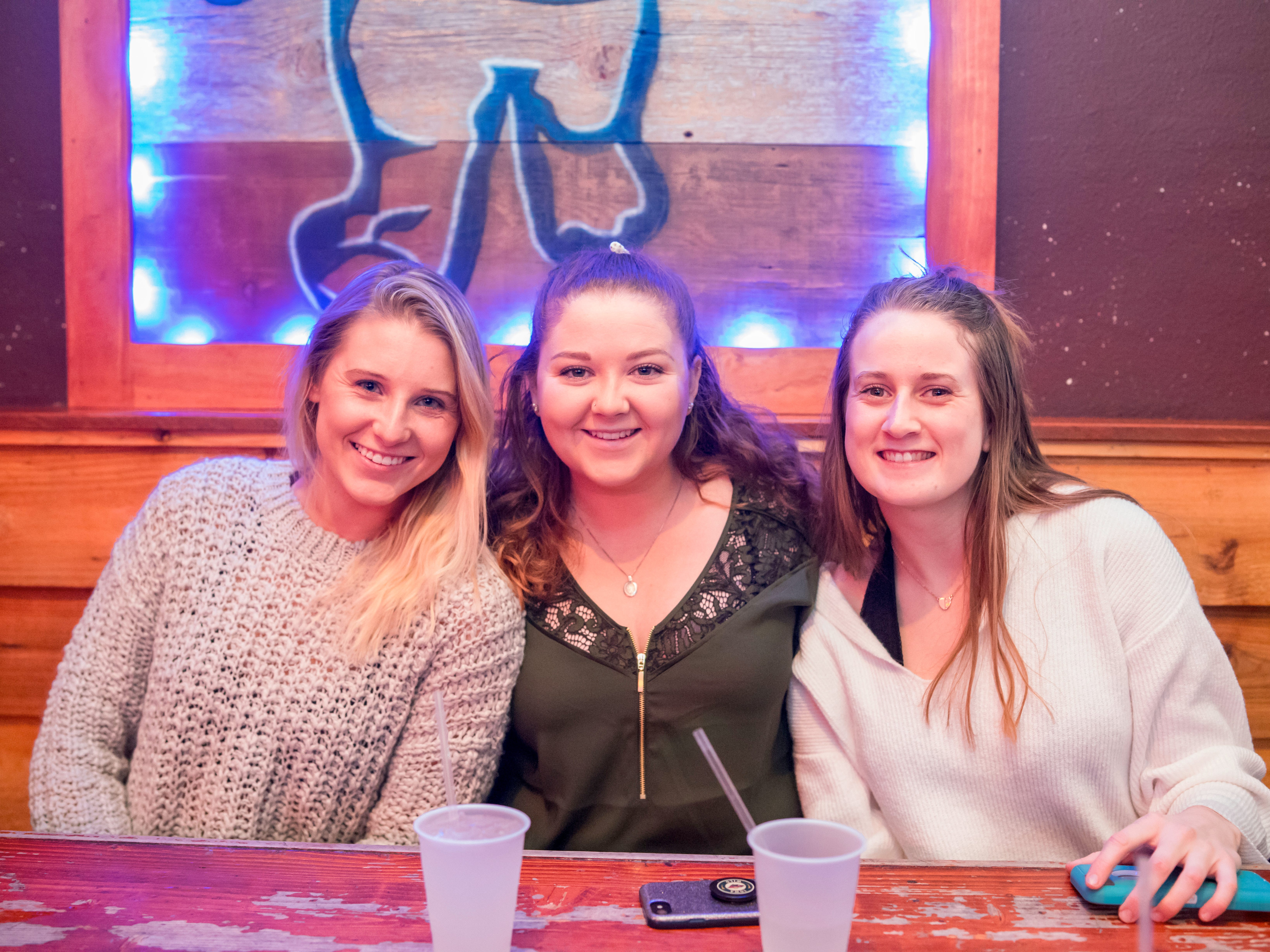Lexi Wagner, 22, Kaylee Gardell, 23, and Brenna Schultz, 21, all of Des Moines, having a fun time,Friday, Dec. 14 at American Outlaws.