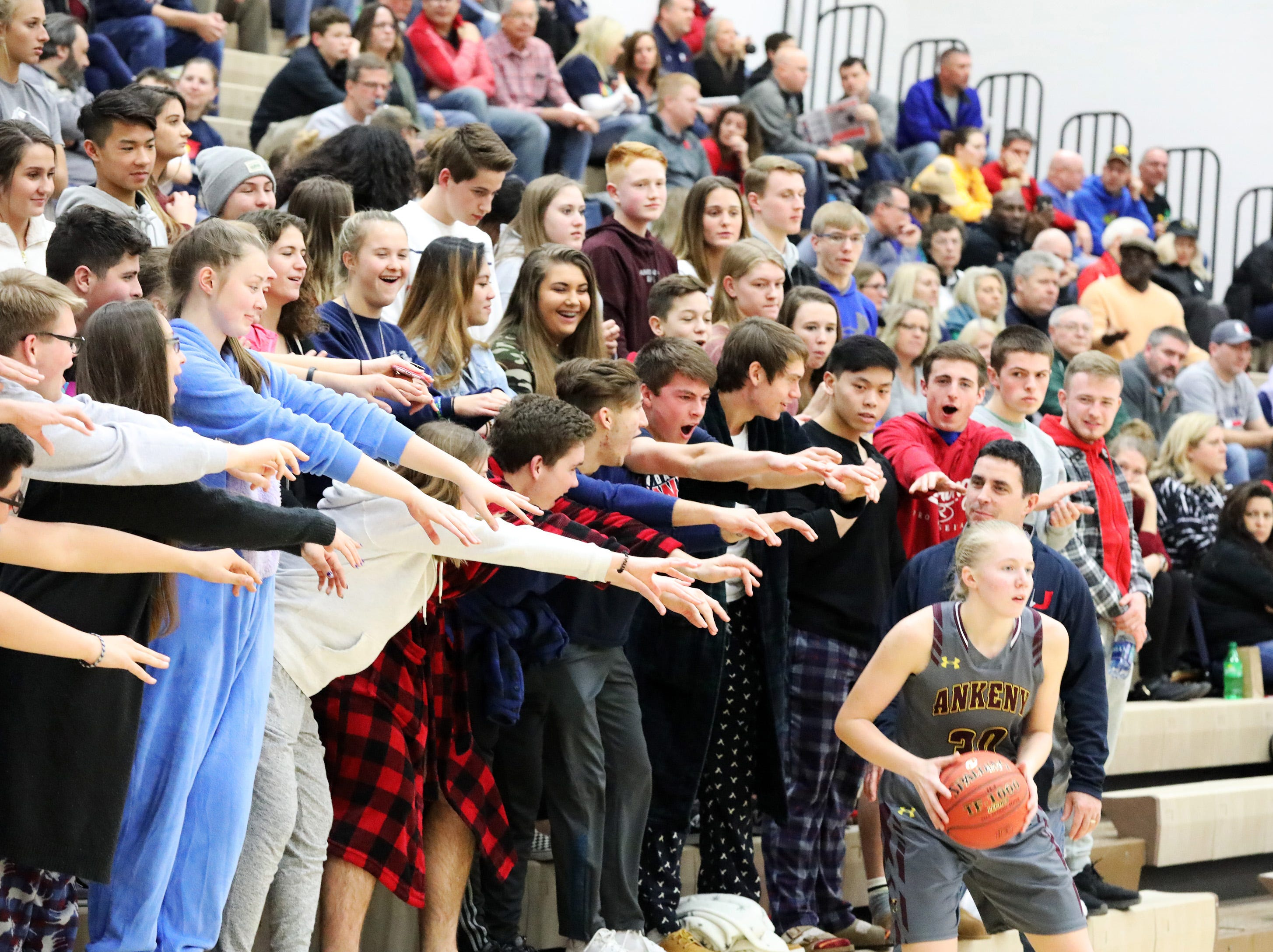 Urbandale students lend a hand to Ankeny sophomore Abby Johnson as the Ankeny Hawkettes compete against the Urbandale J-Hawks in high school basketball on Friday, Dec. 14, 2018 at Urbandale High School. Ankeny won 46 to 40.