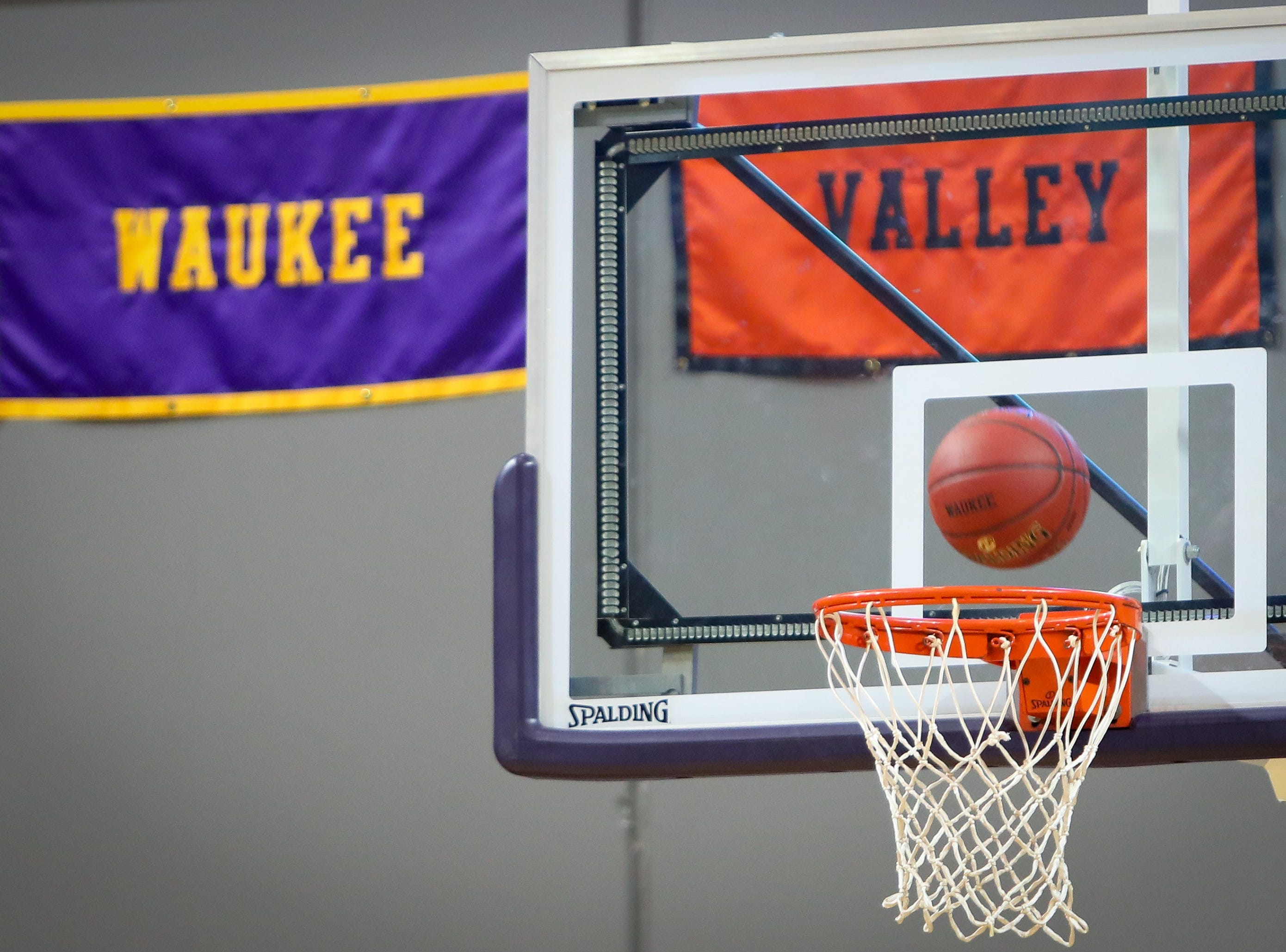 A detailed view of the Waukee and Valley signs is seen during a boys high school basketball game between the Valley Tigers and the Waukee Warriors at Waukee High School on Dec. 14, 2018 in Waukee, Iowa.
