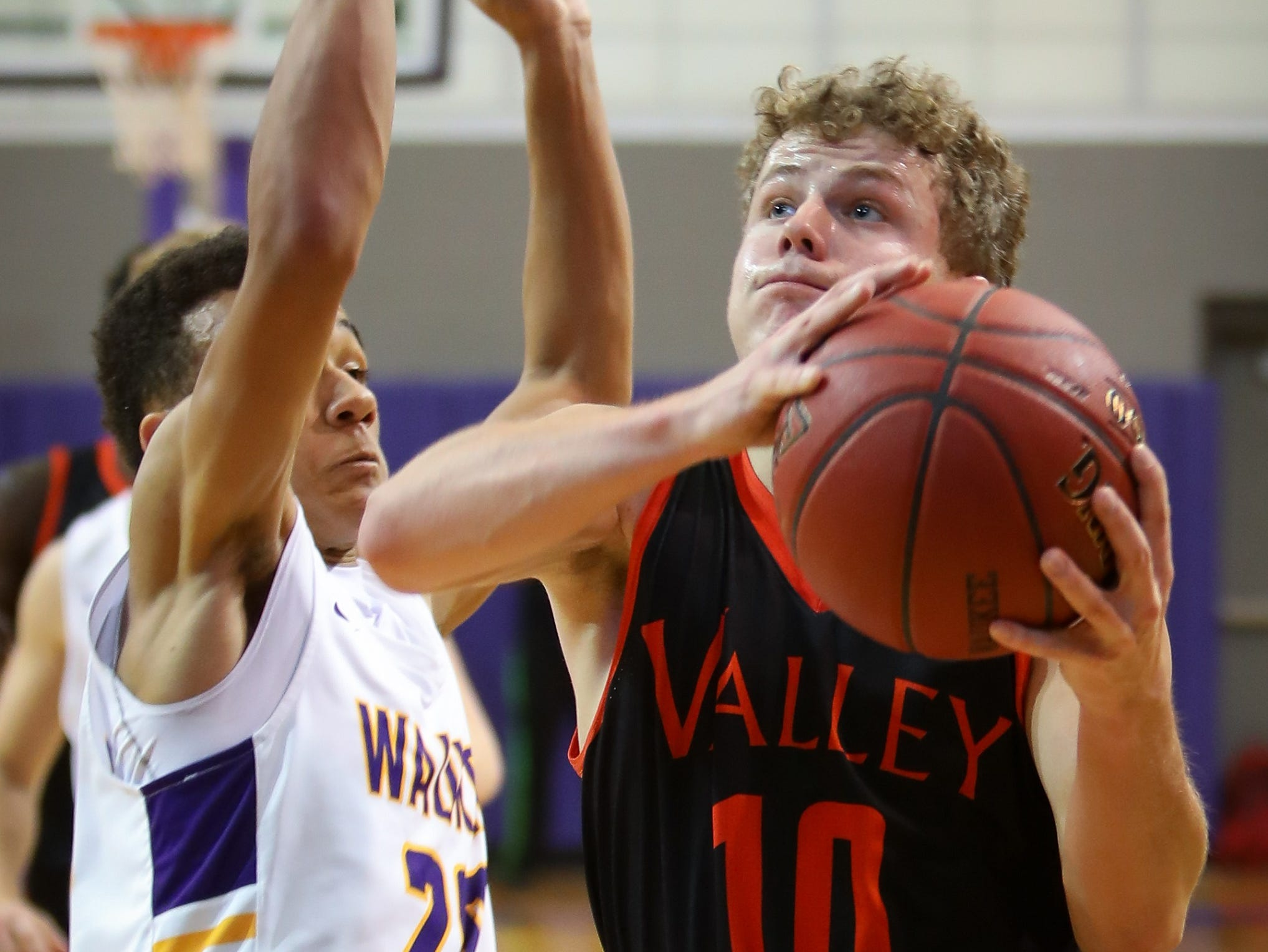 Valley senior Sam Stevens drives to the basket during a boys high school basketball game between the Valley Tigers and the Waukee Warriors at Waukee High School on Dec. 14, 2018 in Waukee, Iowa.