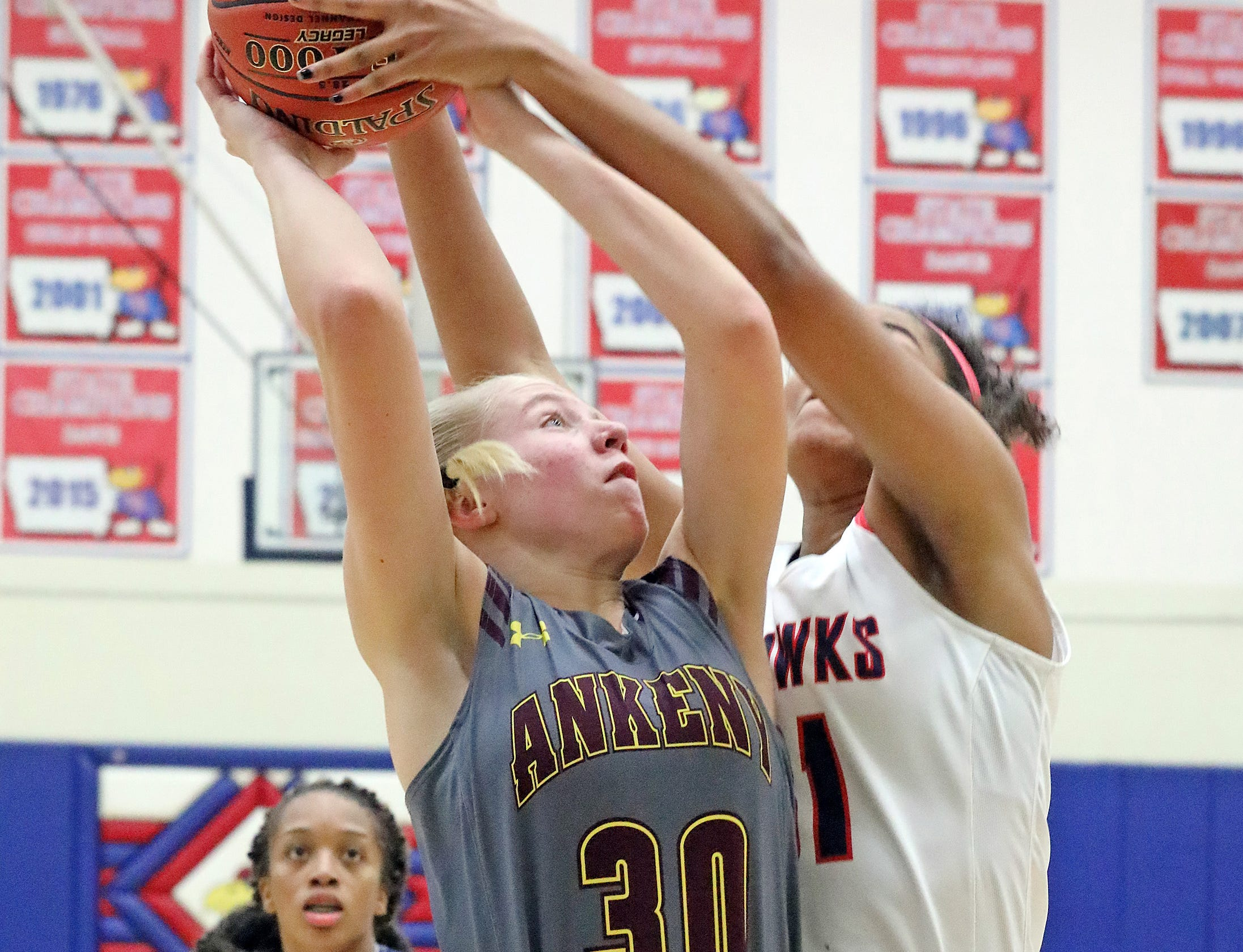 Ankeny sophomore Abby Johnson fights for a rebound as the Ankeny Hawkettes compete against the Urbandale J-Hawks in high school basketball on Friday, Dec. 14, 2018 at Urbandale High School. Ankeny won 46 to 40.
