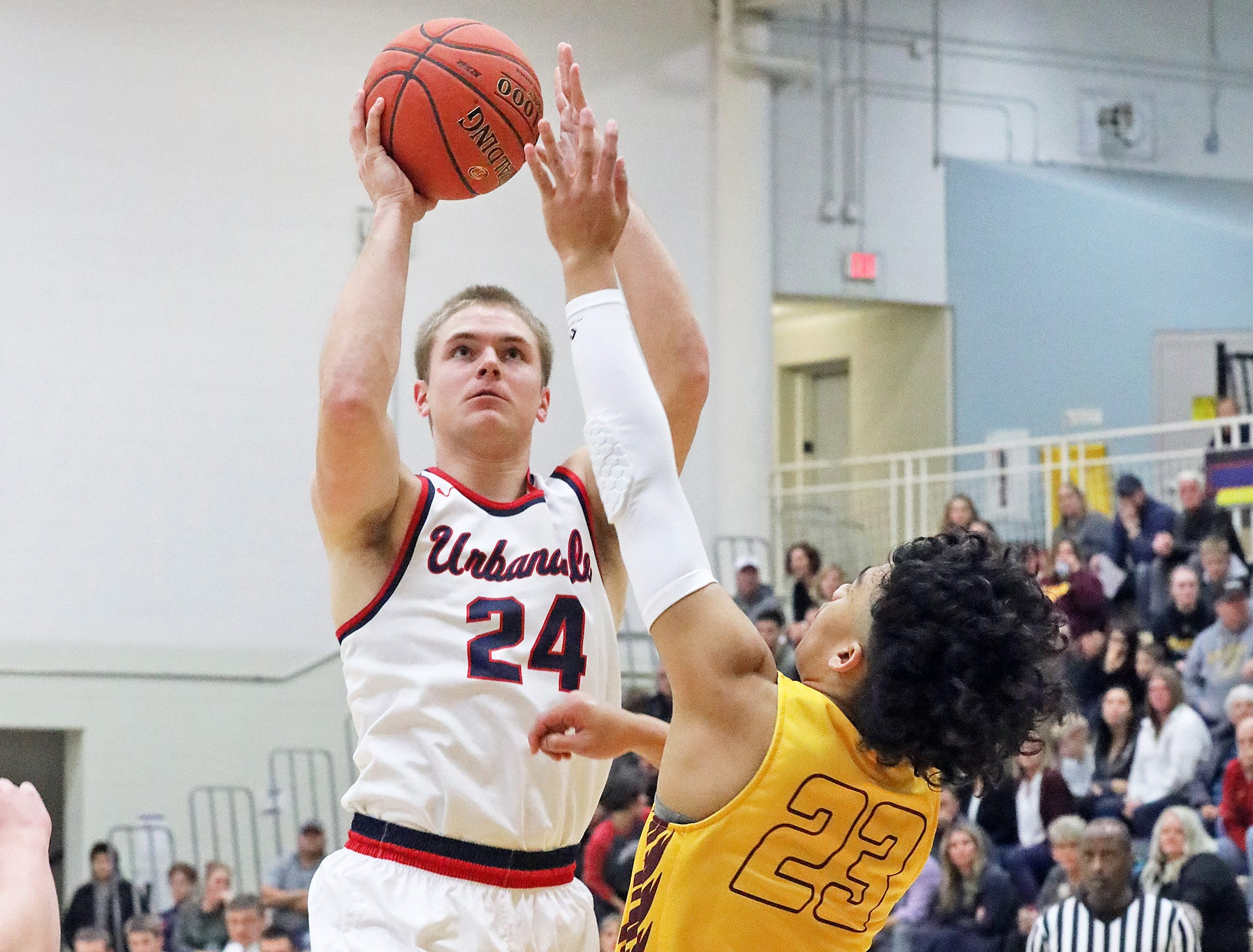 Urbandale senior guard Will Pattison shoots over Ankeny senior Grant Moeller as the Ankeny Hawks compete against the Urbandale J-Hawks in high school basketball on Friday, Dec. 14, 2018 at Urbandale High School.
