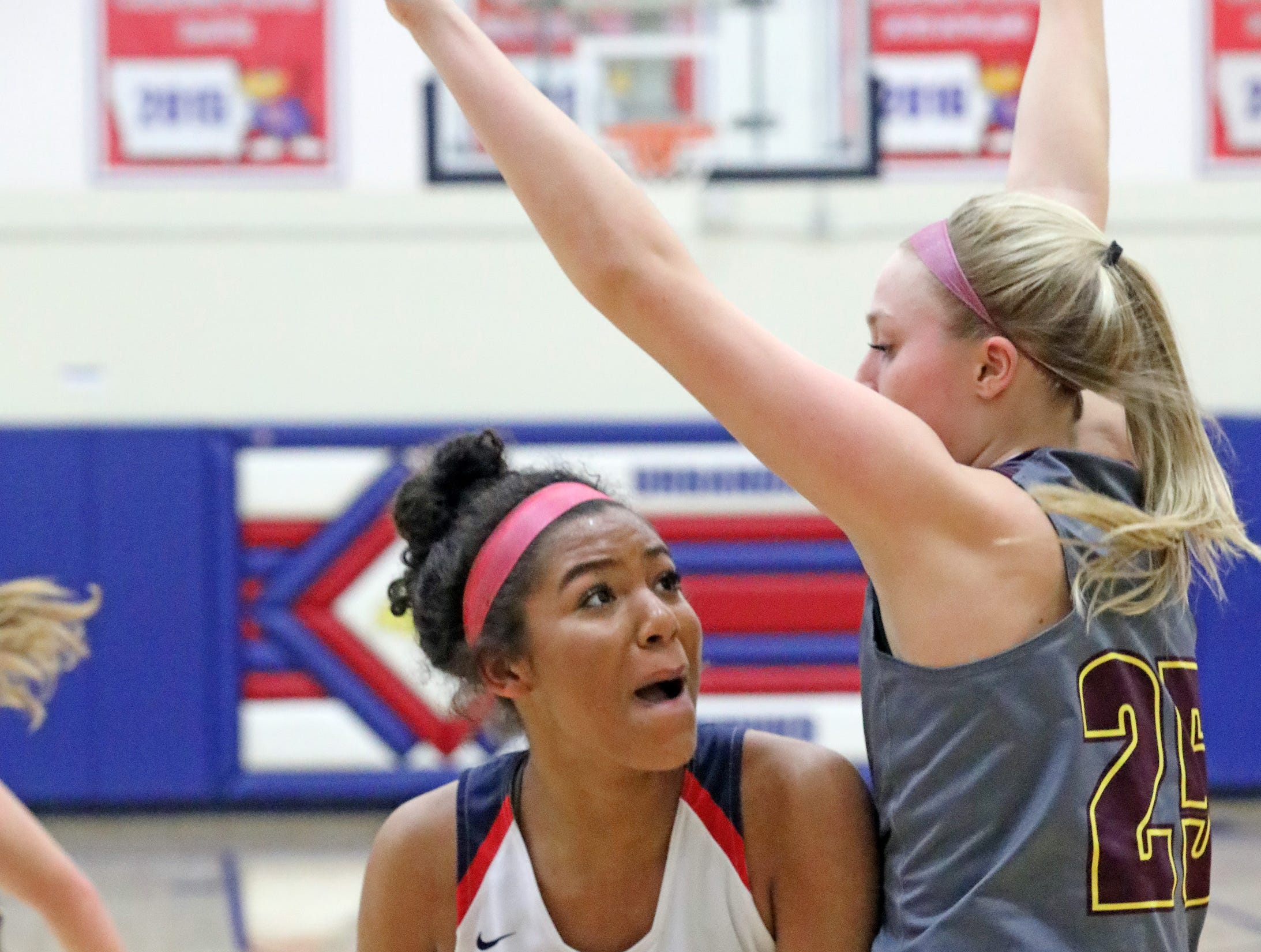 Urbandale freshman forward Jada Gyamfi tries to get past the defense of Ankeny senior Sara McCullough as the Ankeny Hawkettes compete against the Urbandale J-Hawks in high school basketball on Friday, Dec. 14, 2018 at Urbandale High School. Ankeny won 46 to 40.