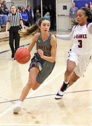 Ankeny junior guard Kayla Pitz drives past Urbandale senior guard Dee Dee Pryor as the Ankeny Hawkettes compete against the Urbandale J-Hawks in high school basketball on Friday, Dec. 14, 2018 at Urbandale High School. Ankeny won 46 to 40.