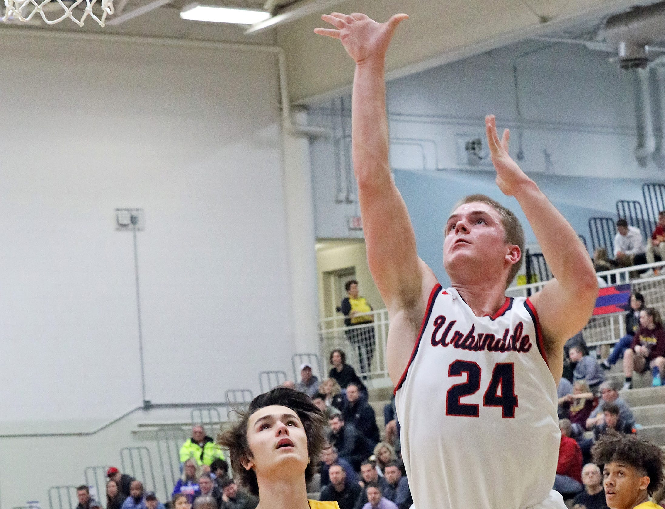 Urbandale senior guard Will Pattison hits the lay-up as the Ankeny Hawks compete against the Urbandale J-Hawks in high school basketball on Friday, Dec. 14, 2018 at Urbandale High School. Ankeny won 62 to 52 to remain undefeated at 6-0.