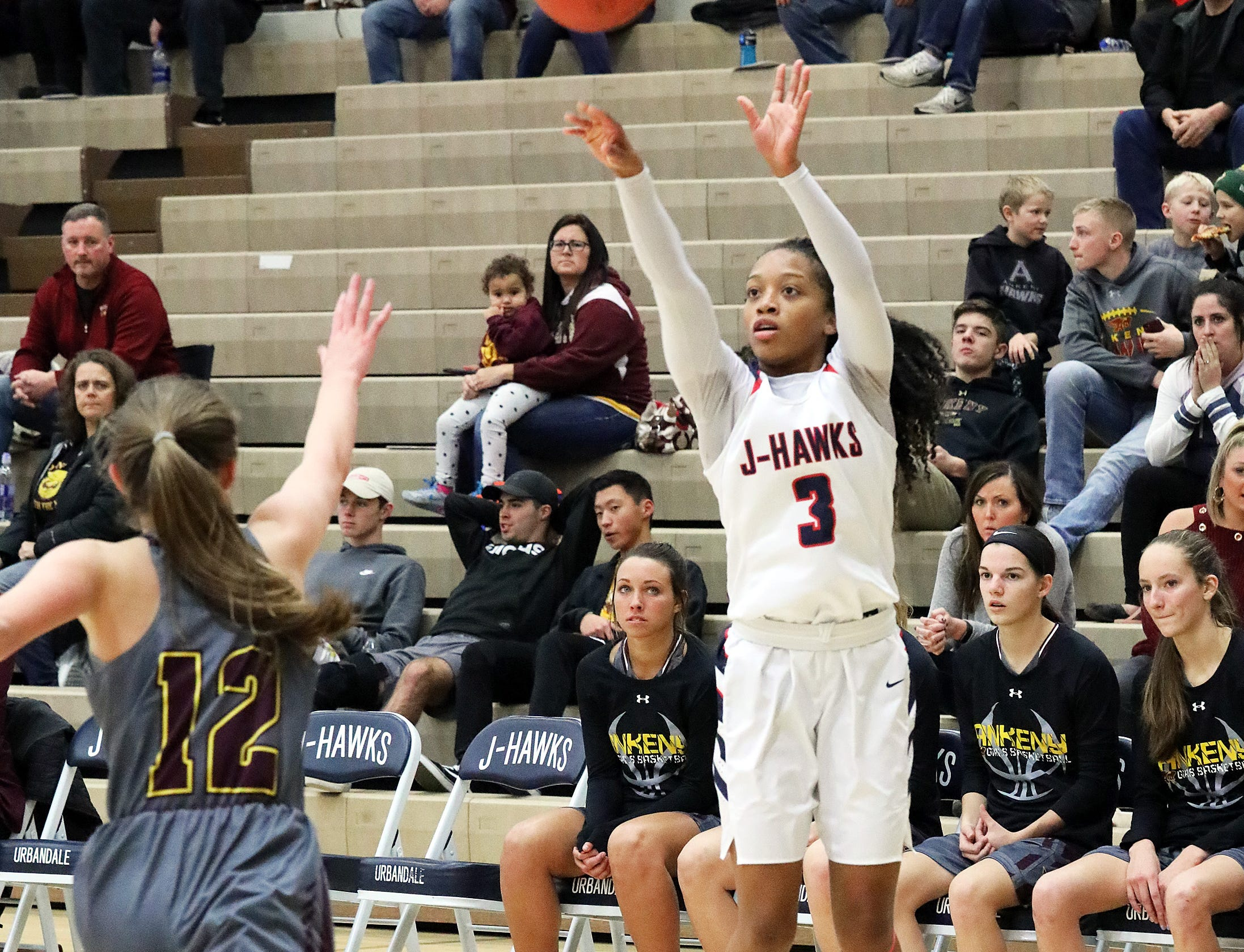 Urbandale senior guard Dee Dee Pryor hits a 3-pointer as the Ankeny Hawkettes compete against the Urbandale J-Hawks in high school basketball on Friday, Dec. 14, 2018 at Urbandale High School. Ankeny won 46 to 40.