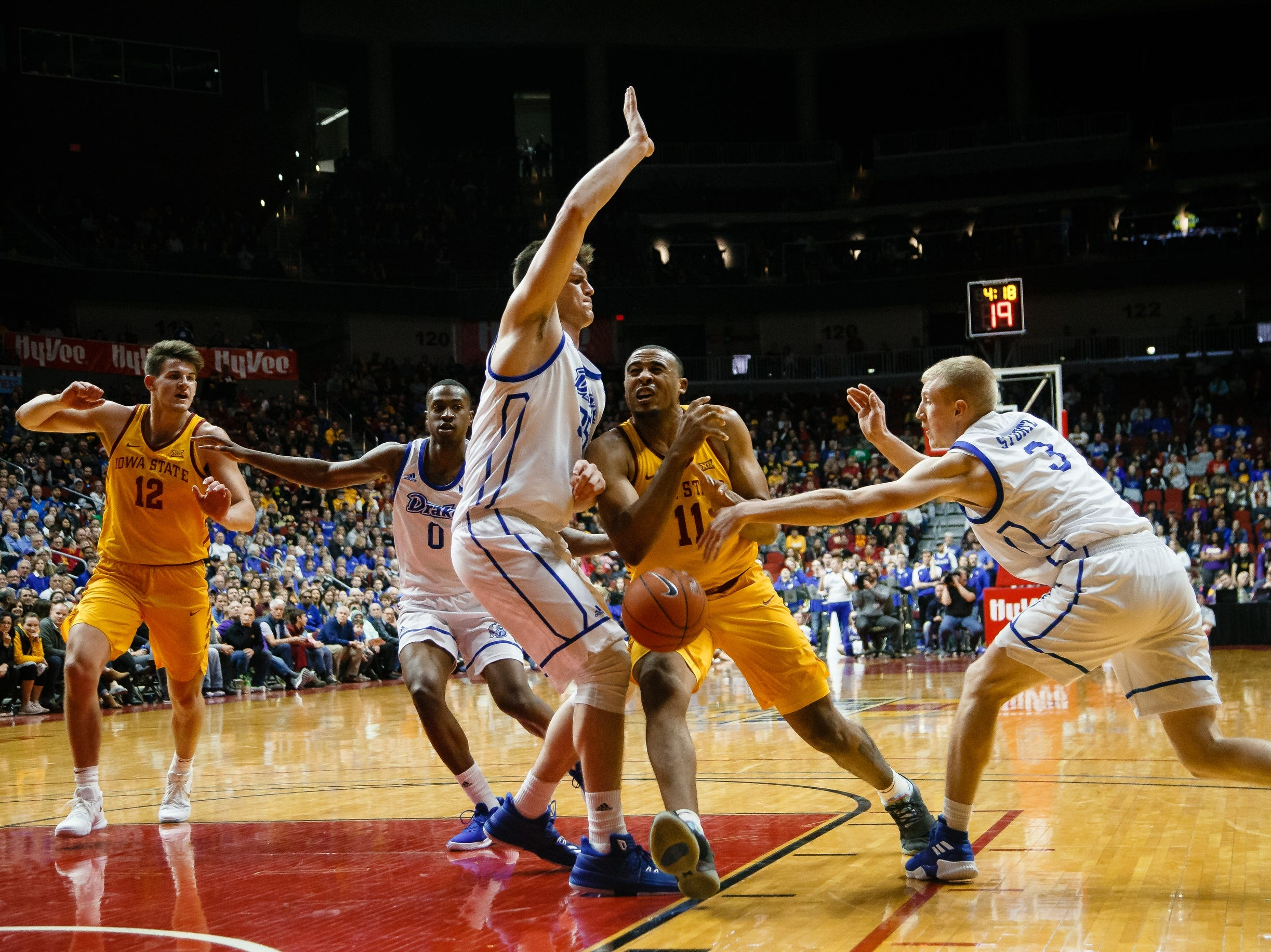 Iowa State's Talen Horton-Tucker (11) is defended by Drake's NickÊMcGlynn (35), left, and Drake's GarrettÊSturtz (3), right, during their basketball game at the Hy-Vee Classic on Saturday, Dec. 15, 2018, in Des Moines. Iowa State would go on to defeat Drake 77-68.