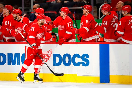 Detroit Red Wings center Luke Glendening (41) is congratulated by teammates after scoring in the first period against the Ottawa Senators at Little Caesars Arena on Friday, Dec. 14, 2018.